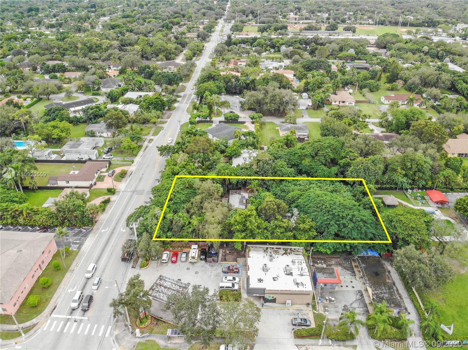 Huge lot in highly sought after South Miami neighborhood. This magnificent piece of property is surrounded by historic trees. At close to 3/4 acre this lot is a dream for a builder/developer. This home is currently occupied, please do not disturb tenants. Priced is based on land value only as the structure may need to be fully renovated or demolished.