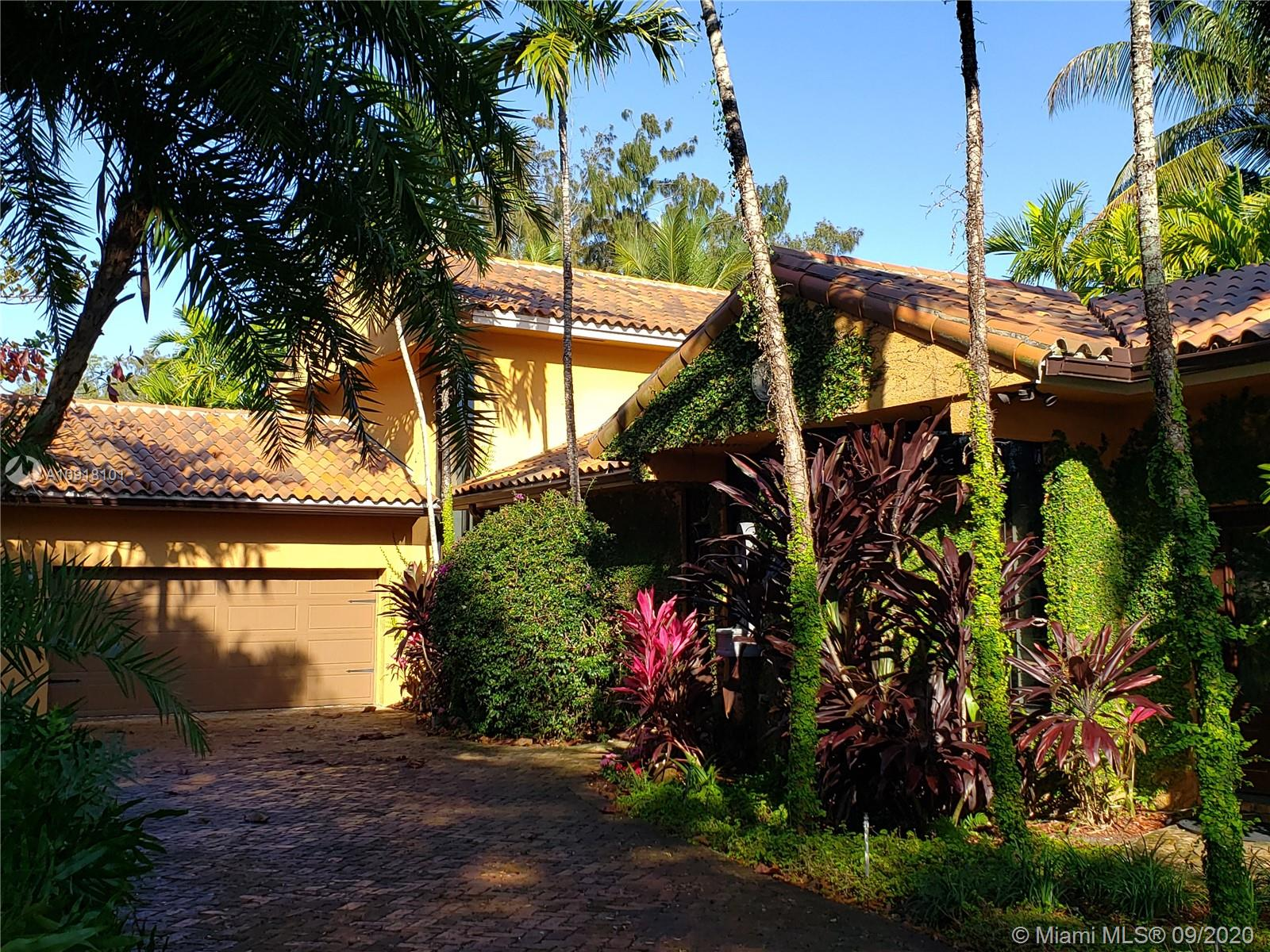 Excellent investment opportunity!   This home is Lakefront w/water views from almost every room! The main house offers three bedrooms- office can become a fourth bedroom, three full baths, four garage spaces. Large one bed/two bath attached GUEST HOUSE/IN LAW independent from the main home. Huge family room - floor to ceiling windows. The central kitchen has a gas stove & high-end appliances, and there is a second kitchen in the guest house.  Impact windows & garage doors. Private master suite entire second floor, renovated bathroom, personal terrace w/direct lake view. Lots of storage. Beautiful backyard large unusual circle shaped pool, fountain, dock & fixed gazebo overlooking the lake. Perfect home for entertaining! Superb location.   This home is rented until May 2021.  Make an offer