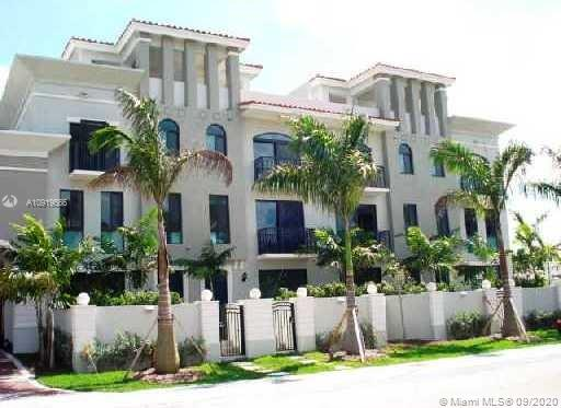 LUXURY FOUR STORY 5BED/3BATH TOWNHOUSE LOCATED IN ONE OF MIAMI'S MOST EXCLUSIVE AREAS. WALKING DISTANCE TO BAL HARBOR SHOPS, RESTAURANTS, BEACH AND A GRADE SCHOOLS. SAFE AND TRANQUIL COMMUNITY WITH AMAZING PARKS AND PUBLIC AREAS. PRIVATE AND SAFE GATED SMALL VILLAGE. MODERN PORCELAIN TILE FLOORS, PRIVATE ELEVATOR, STAINLESS STEEL APPLIANCES, TWO PARKING SPACES, TWO OUTDOOR PRIVATE SPACES (FIRST AND TOP FLOORS), COMMUNITY POOL AND GYM.