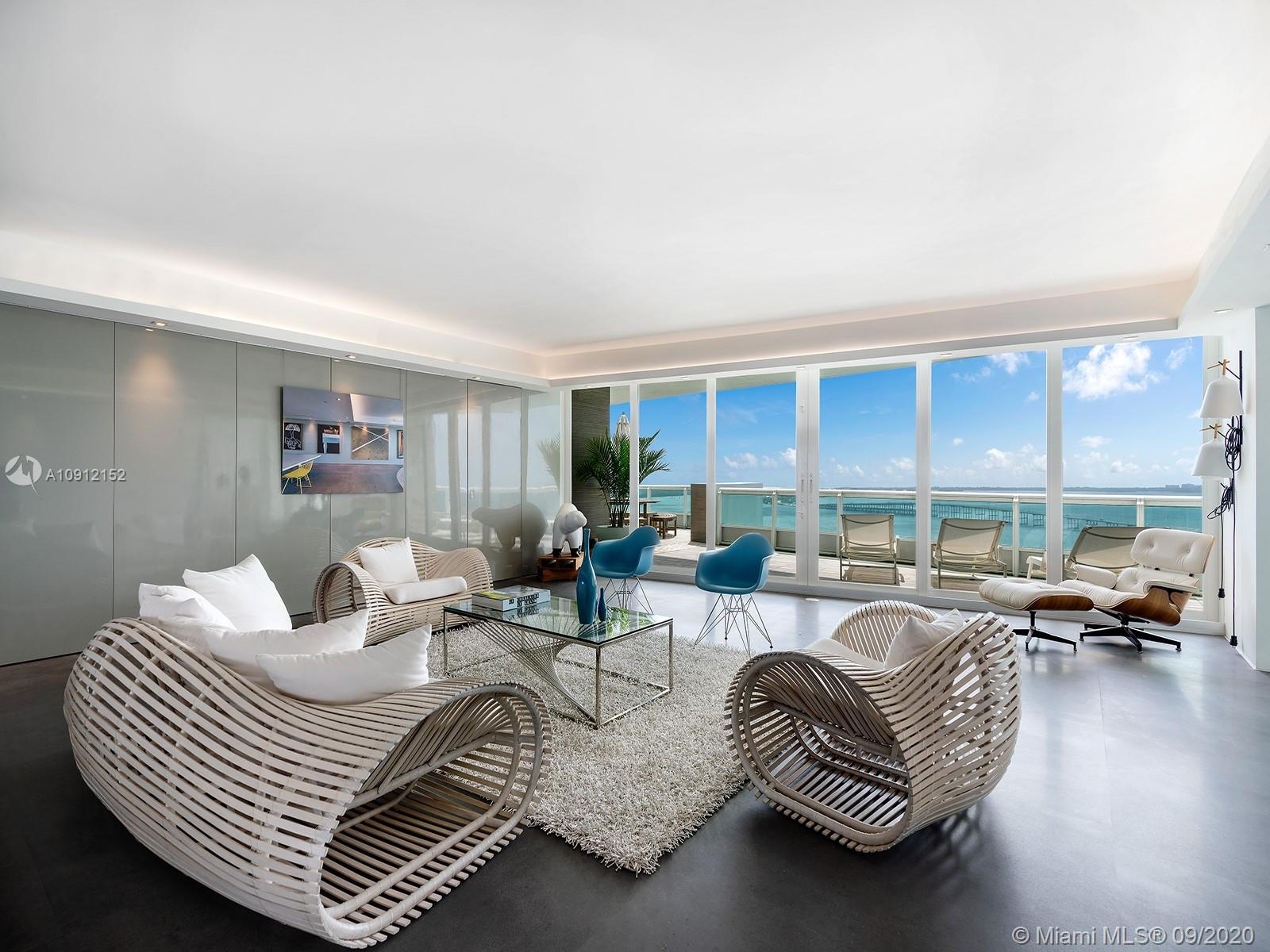 This luxe residence on the 27th floor of the Santa Maria tower on Miami's Brickell Avenue was recently completely renovated to become a serene contemporary space. With spectacular views to the east and west, overlooking Biscayne Bay, the Miami skyline, and the ocean in the distance, this floor-spanning unit is one of only two in the building with extra-deep, landscaped terraces like this. A centerpiece of the unit is the glass wine cellar, which is connected to the full wet bar. The Santa Maria offers a resident clubhouse in a historic mansion on the lush grounds, a large fitness center on the building's rooftop, a bayfront pool, a marina, tennis courts, and a location in the heart of Miami, with excellent access to the excitement of Downtown Miami and Coconut Grove.