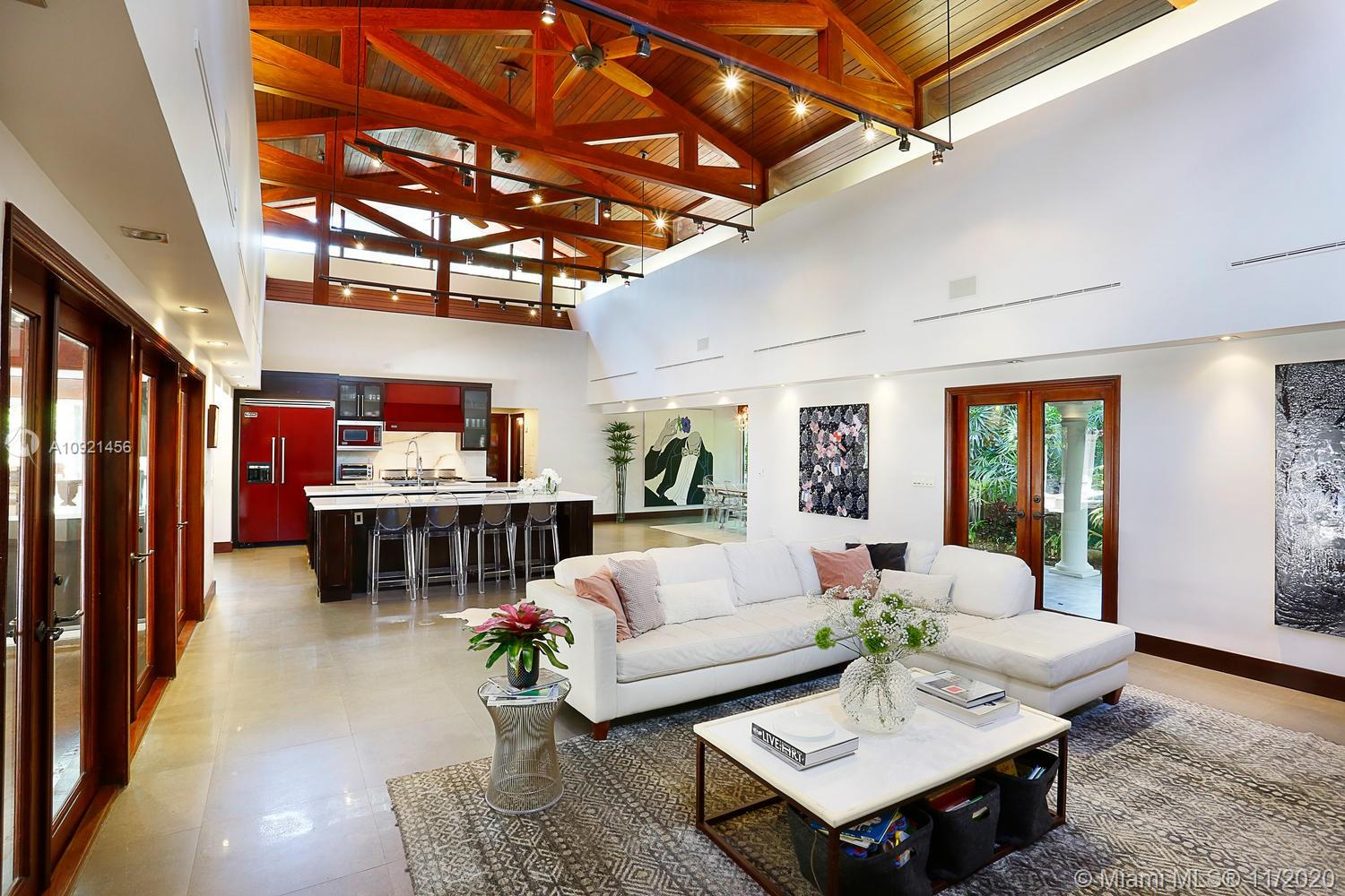 "Ultra-private, walled & gated retreat surrounded by magical tropical gardens set under a lush tree canopy. Architecturally unique design with expansive interior courtyard & deep covered terraces that connect the ""Main Living Wing"" and separate ""Bedroom Wing"". Dramatic, light-filled living areas w/ soaring, vaulted wood-beamed ceilings and walls of glass that create a seamless blending of interior & exterior spaces. Spectacular, multi-island kitchen has bar seating & Viking appliances, including commercial-style 6-burner gas range. Notable features include glass enclosed formal dining room, den/office with wet bar & master suite featuring sitting room & luxurious spa-like bath w/soaking tub & shower. Walk or bike to the Grove village center's boutiques, cafes & bayfront parks & marinas."
