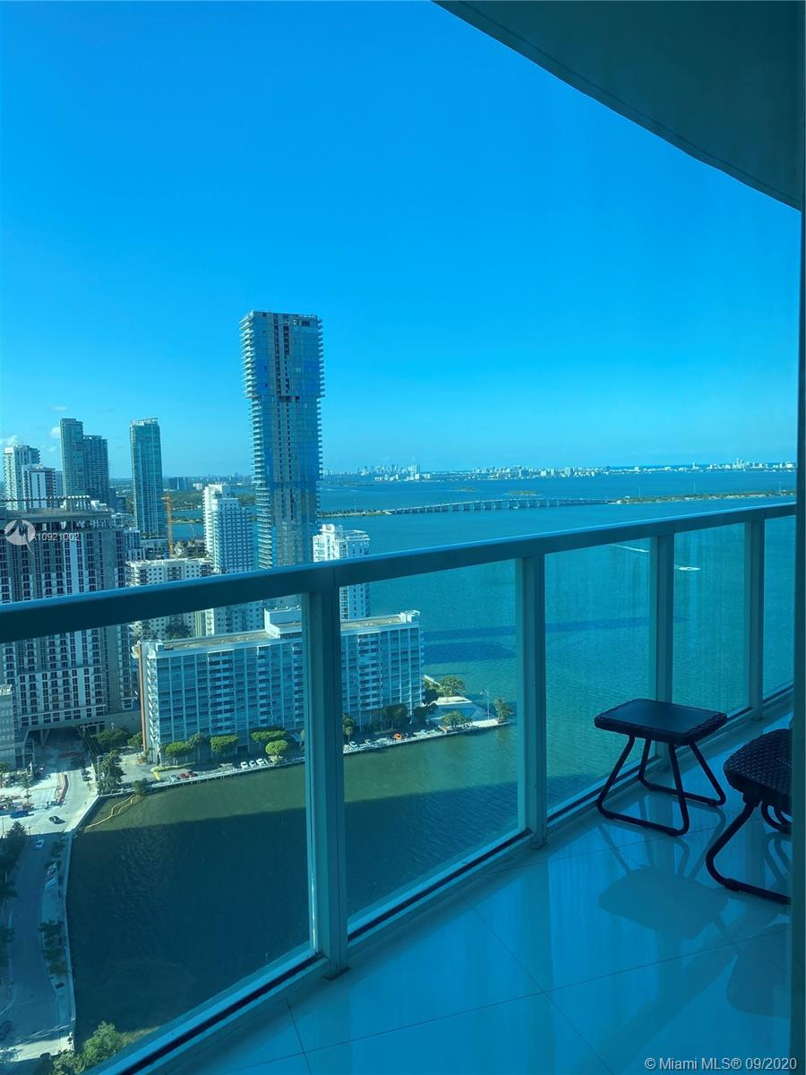 Absolutely beautiful and totally remodeled unit at Quantum on the Bay, 1bed+Den and 1bath, Gorgeous view of the Bay and Miami Beach, North east exposure, unit features: beautiful white porcelain floors through out and on balcony, new modern lighting, italian kitchen and modern bathroom, Den with murphy bed can be a guest room, full size W&D... enjoy the amazing views from the bedroom.. building features: 2 pools, state of the art gym, modern residents lounge, theatre room, sauna, valet, convenient store and more. Beautiful Park across the street and restaurants just steps away from the building. BEST 1BED UNIT IN THE BUILDING Rent covers: high speed internet, water, and sewer