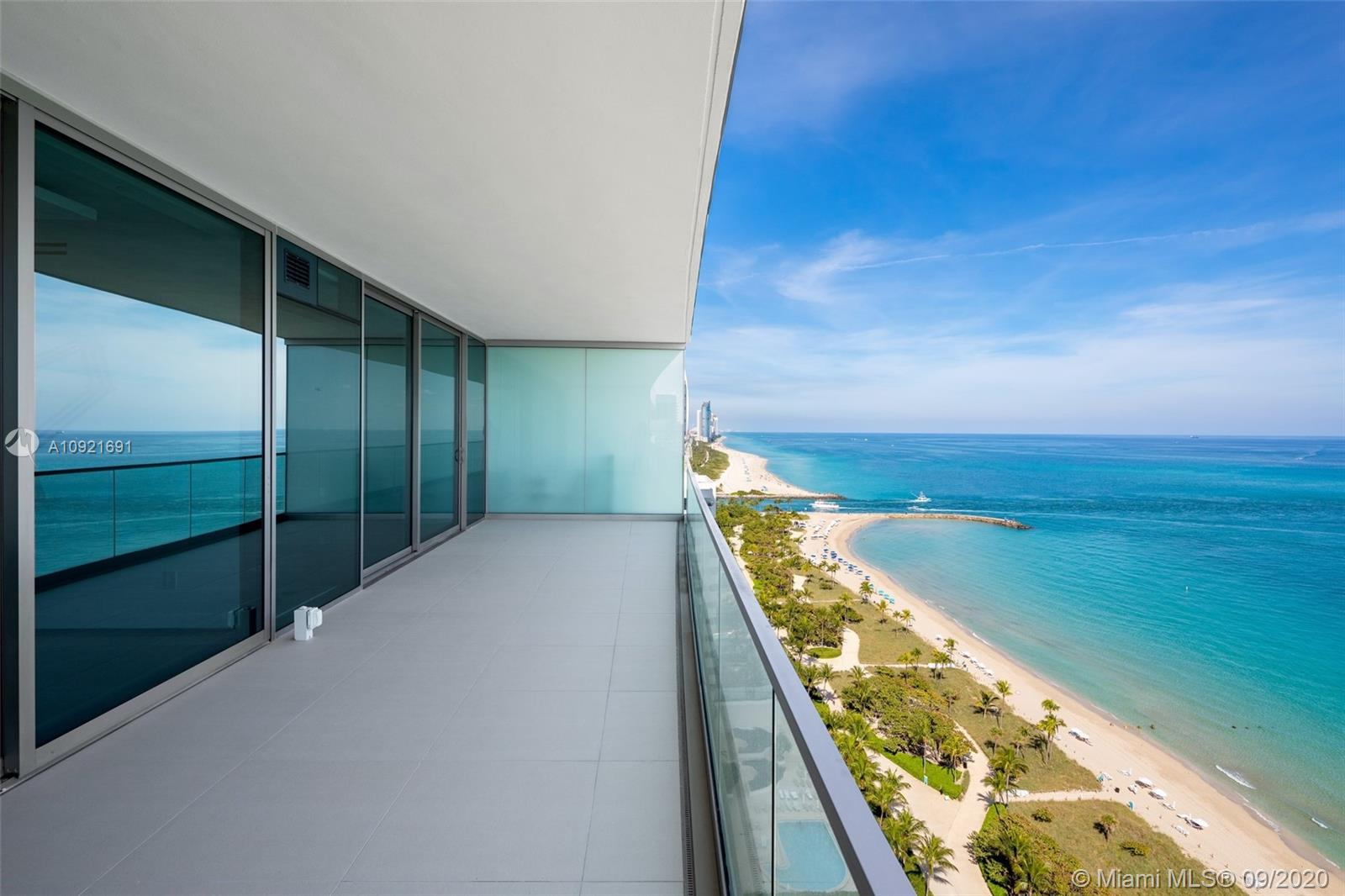 Located in prestigious Oceana Bal Harbour, this stunningly designed high floor flow-thru residence is ocean front luxury living redefined. Sold furnished with the latest Minotti line, this sleek & modern 3,264 SF flow-thru residence boasts unobstructed views to the Atlantic Ocean, Biscayne Bay, & Downtown Miami skyline. Enjoy complete privacy inside your residence & as you step out onto your 9 Ft. deep terraces. Sophisticated elegance abounds with exquisite stone flooring throughout & the latest Italian Doors & Closets. Gourmet Kitchen with Dada Cabinetry & Gaggenau appliances. Oceana's 5-star amenities cater to a select few: beautifully manicured grounds, private restaurant, beach service, tennis courts, museum quality art with sculptures by Jeff Koons. Unit Designed by Cleo Bell.