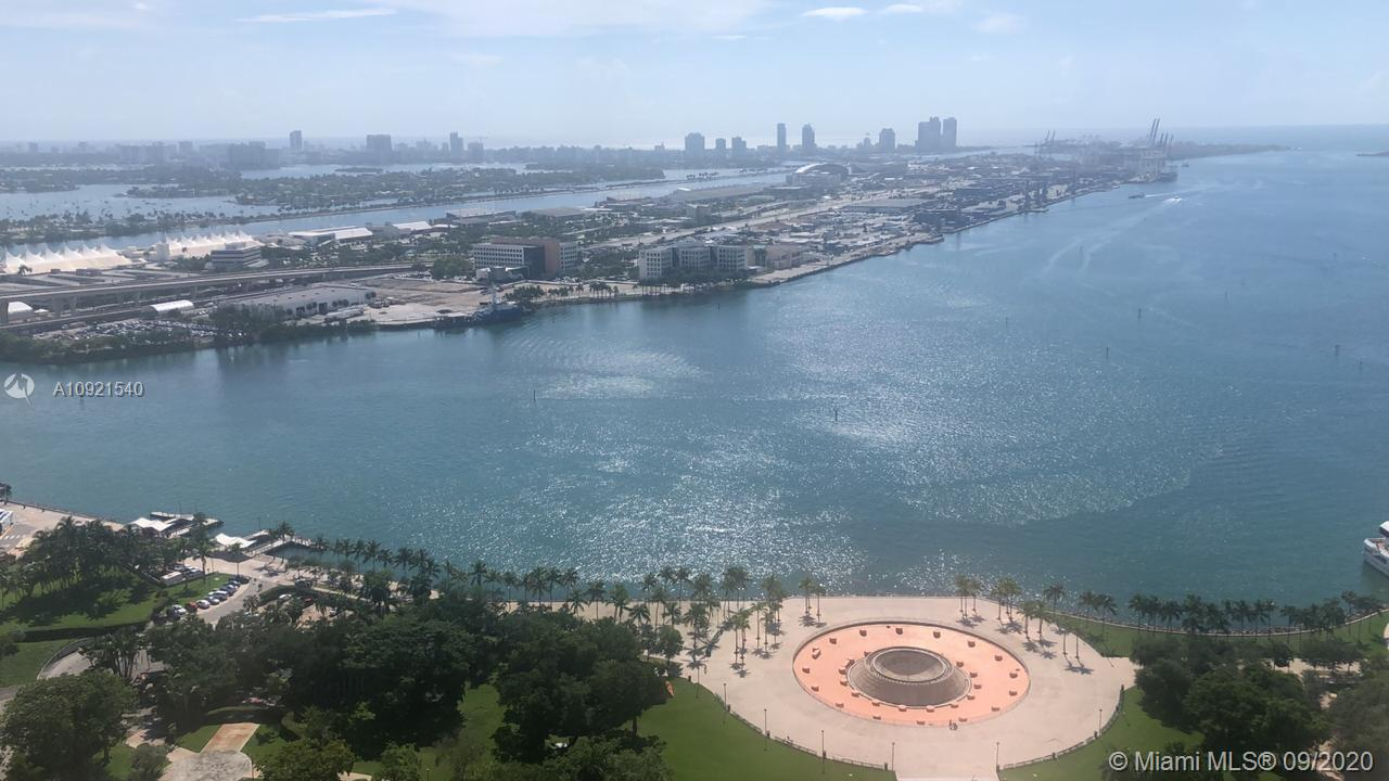 +Turn- Key furnished unit. TWO bedroom + DEN (could use as a 3rd bedroom, office or dining room), two baths. Split floor plan and 1357 Sq Ft. Spectacular direct views to Biscayne Bay and Bayfront Park. Sub-zero refrigerator and stainless steel appliances, Euro style cabinets in kitchen and granite countertop, white Porcelain tile & marble bathrooms. Floor to ceiling windows. Full laundry inside the Apartment. Amenities include: heated pool, fitness center w/ spa, sauna & classes, clubhouse, 24-hr security, valet, concierge, Cable TV + Internet. Centrally located, walk to Bayside, AA Arena, and just minutes away from Brickell City Center