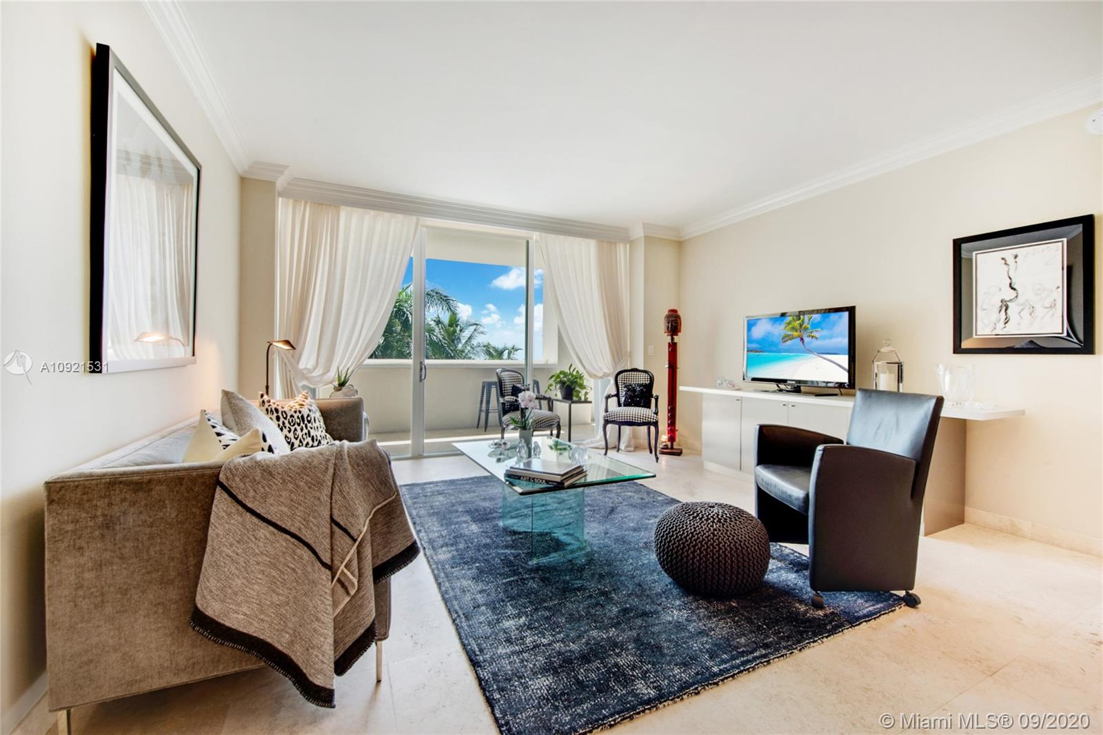 "Large one-bedroom with water and park views at the Ritz-Carlton in the heart of Coconut Grove across from Biscayne Bay, Regatta park and the marina. Updated kitchen with all new appliances, Poggenpohl cabinets and granite countertops. 18""x18"" marble floors throughout. Large master bedroom with two walk-in closets and luxurious master bath with separate shower and tub and dual sinks.  261 SF terrace overlooking the bay, park and pool. Access to all 5-star hotel amenities including full-service pool, spa, fitness center, restaurants & bars, concierge and valet parking plus residents-only amenities. Walking distance to waterfront parks, restaurants, shops and entertainment. Easy drive to Miami Beach, Downtown Miami, Coral Gables and the Miami International Airport. Easy to show."
