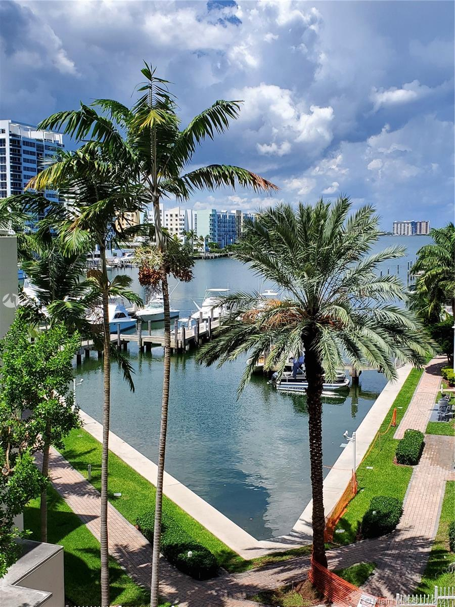 MOTIVATED SELLER! LARGEST WATERFRONT 2 BEDROOM 2 BATH UNIT WITH PRIVACY BALCONY.  SPECTACULAR VIEWS OF BISCAYNE BAY FROM BOTH MASTER BEDROOM AND LIVING ROOM. IMPACT RESISTANT FLOOR TO CEILING WINDOWS AND SLIDING GLASS DOORS. WASHER & DRYER IN UNIT. HOA INCLUDES BASIC CABLE & INTERNET.THIS RESORT STYLE COMMUNITY OFFERS AMAZING AMENITIES INCLUDING GYM, HIS & HERS SAUNAS, 2 POOLS, CLUB HOUSE, 24 HRS GATED SECURITY WITH FREE VALET, LOTS OF GUEST PARKING AND A PRIVATE MARINA. CONVENIENTLY LOCATED TO MAJOR THOROUGHFARES, AREA RESTAURANTS & LESS THAN 3 MILES TO THE BEACH.