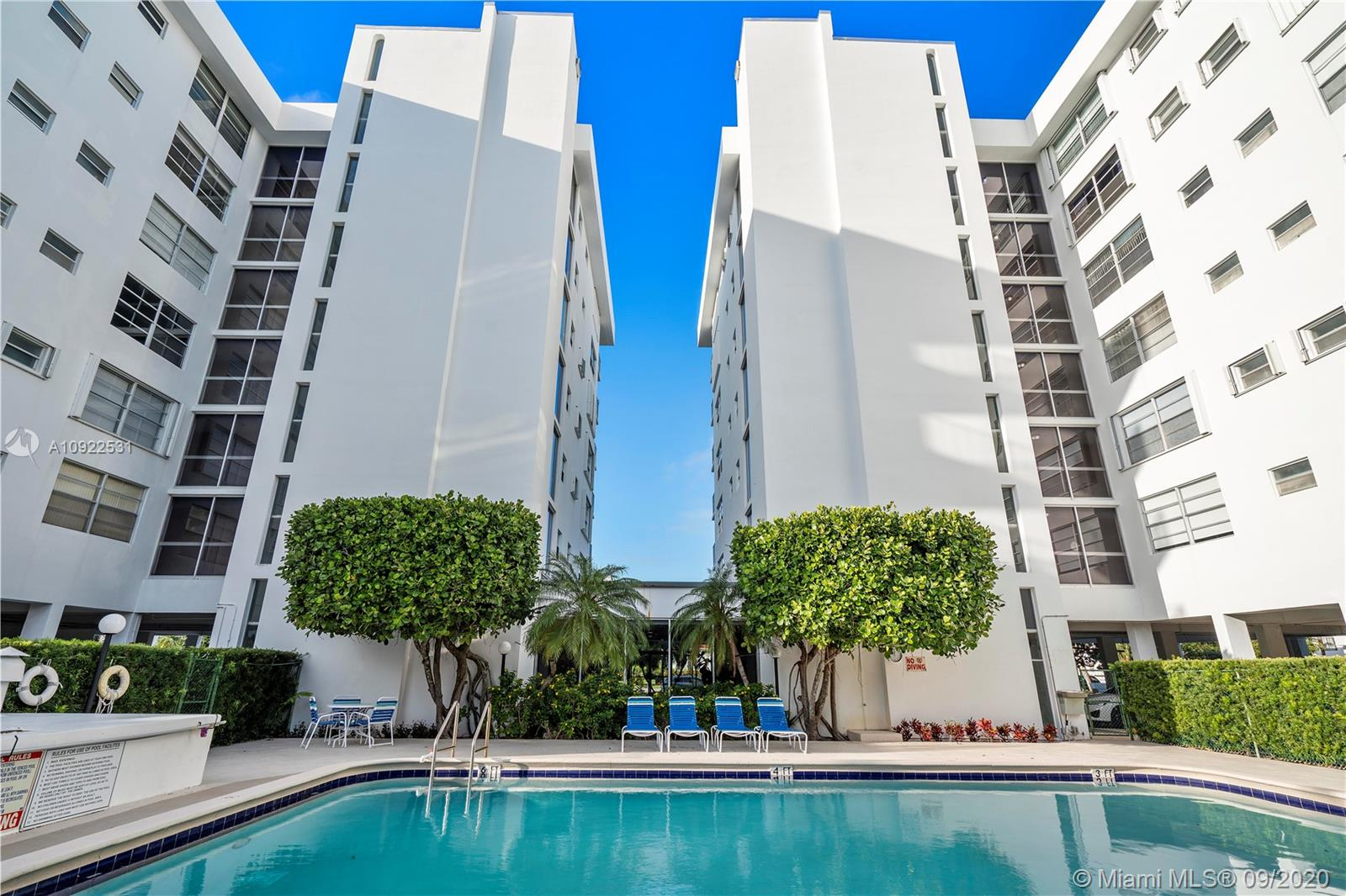 Spacious & bright corner unit in the heart of Bay Harbor Islands. Open kitchen w/ updated stainless steel appliances, granite counter tops and large pantry. Tile floors throughout. Unit comes w/ 2 parking spaces. Storage unit located on the same floor as the apt. Oversized master bedroom w/ large walk in closet. Building is secure and well maintained w/ a small gym and recreation room. Large pool area. Cable TV & internet are included in HOA. Half block away from A+ Rated Bay Harbor K-8th Grade. Lots of guest parking available. Cannot rent for first 2 years of ownership. No pets.