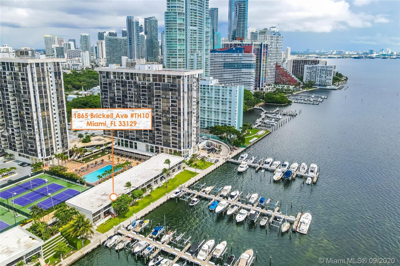 Fantastic townhouse right on Biscayne Bay facing Rickenbacker causeway. Partially remodeled. Two covered private parking spaces. The townhouse gives you the independence of a private home with the comfort of a first class condominium. Experience living next to the water in the heart of Miami Brickell Area. Second bedroom has been divided in 2 smaller rooms. Owner financing available, Condo expenses have been capped.