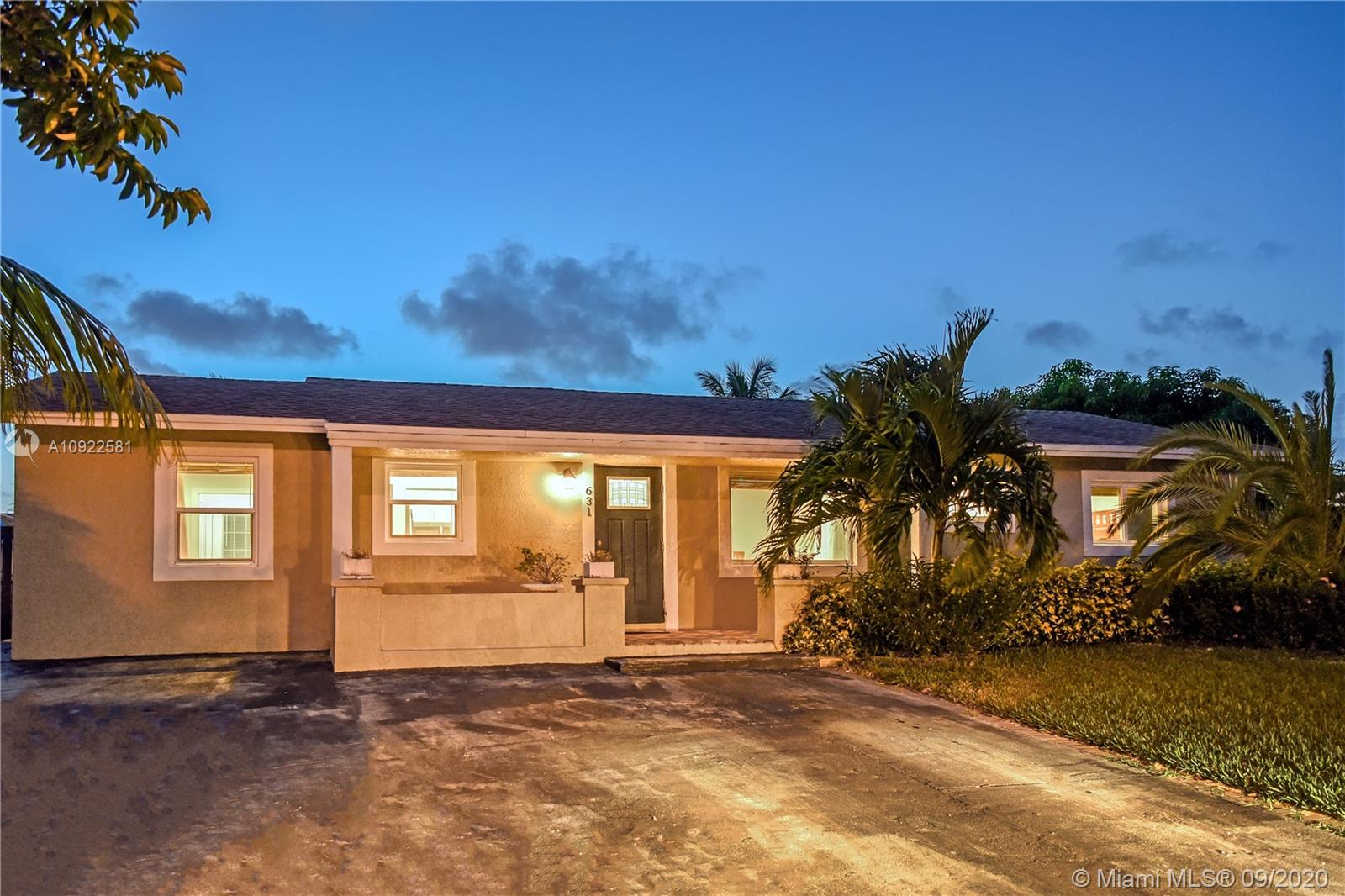 Experience Florida Beach life in a beautiful renovated House on the cul-de-sac. Stylish and immaculate, this home was renovated with pristine taste and attention to all detail. Enjoy both indoor and outdoor living in your large backyard, under covered entertaining area overlooking outdoor gourmet kitchen and completely fenced well maintained expansive grassy yard. All NEW IMPACT WINDOWS & DOORS, new floors throughout, open style kitchen , quartz countertops, with a beautiful island and stainless steel appliances. The bathrooms include magnificent tile selections, modern vanities, waterless tank, AC 4 years old. Space to park your boat or RV. Minutes from sandy beaches and a magnificent fishing pier, shopping and entertainment options.