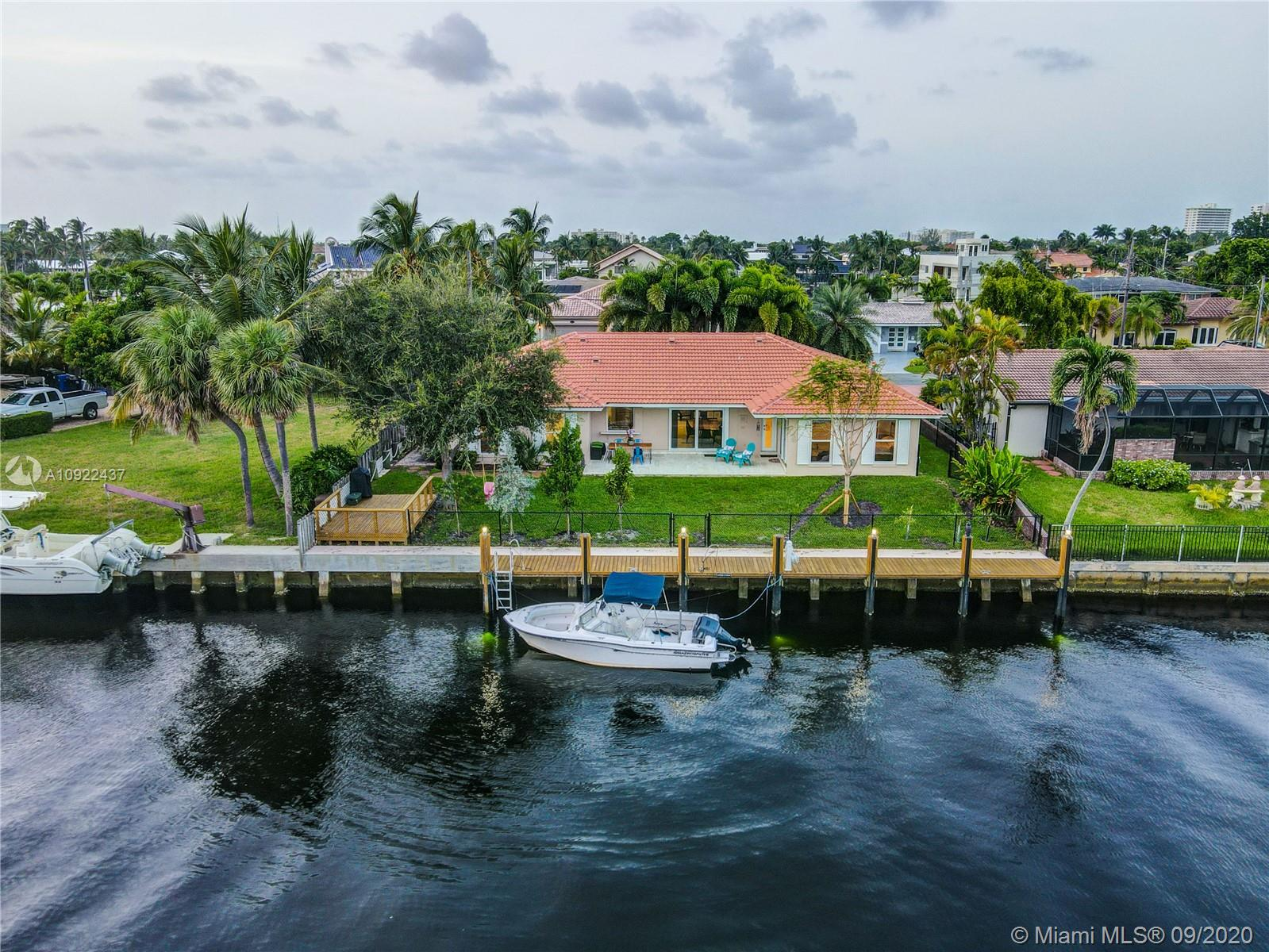 Beautifully remodeled Bermuda Riviera home on Galt Ocean Mile. This house has been completely remodeled w/high end finishes. Foyer entry leads to open floor plan w/sweeping water views from almost every room. The 4 BDRM's are split w master suite & walk-in closet. 80ft of water w/ocean access from wide canal feeding to  Intracoastal. New 60 foot dock w/underwater lighting, new seawall cap & new higher code height. The cabana bath has a double vanity. New roof, new A/C, & all impact windows & doors. Crown molding, plantation shutters & baseboard, brand new appliances. Gourmet kitchen crafted from a renowned designer w/all quartz kitchen counter tops with 9 ft waterfall island,& dual zone wine cooler. Gated community, walking distance to shops & restaurants. Top rated Bayview school district