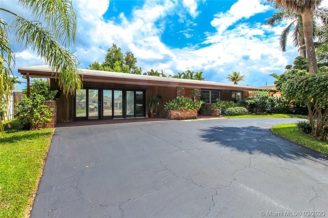 A One-of-a-kind Mid-Century Home in a very desirable neighborhood! Open floor perfect for entertainment. Brand new Impact Doors and Windows! Split bedrooms - Master suite has a private courtyard retreat. Expansive outdoor space with plenty of room for pool. Carport converted into office or additional living area. Surrounded by excellent schools: Pine Crest & Floranada. Close to all shops, restaurants and beach!