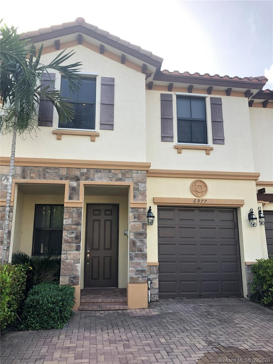 Virtual Showing Available! Magnificent townhome in Coconut Creek located near some of the best schools in town. Granite kitchen with dark wood cabinets, beautiful back splash and a full size pantry. Open layout design with separate Florida room and living room. Private backyard ready for entertaining Duel sinks in both upstairs bathrooms with a tub in the second bath. Tile throughout the first floor with carpet on the stairs and 2nd floor. 1 car garage with an auto door opener and room for 2 cars in the driveway. Low HOA fees and great location.