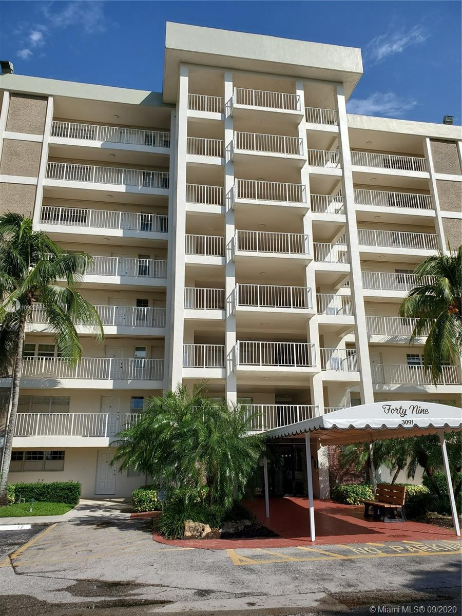 Excellent two bedroom/two bath Condo with Beautiful Lake views from Balcony. Upgraded Kitchen & Bathrooms with granite and new cabinets. Tiled Kitchen & Bathrooms and Carpeted Living room and bedrooms. Great Community Pool and Pavilion area. Palm-Aire is a well maintained Condo Community. Laundry facilities on each floor. Secured Building with Keypad Entry. Assigned parking spot and plenty of guest parking. The Unit includes Cable, WiFi, Internet & Water. Close to shopping, grocery stores and major highways(Turnpike & I-95). Only Two cats allowed for pets by Association.