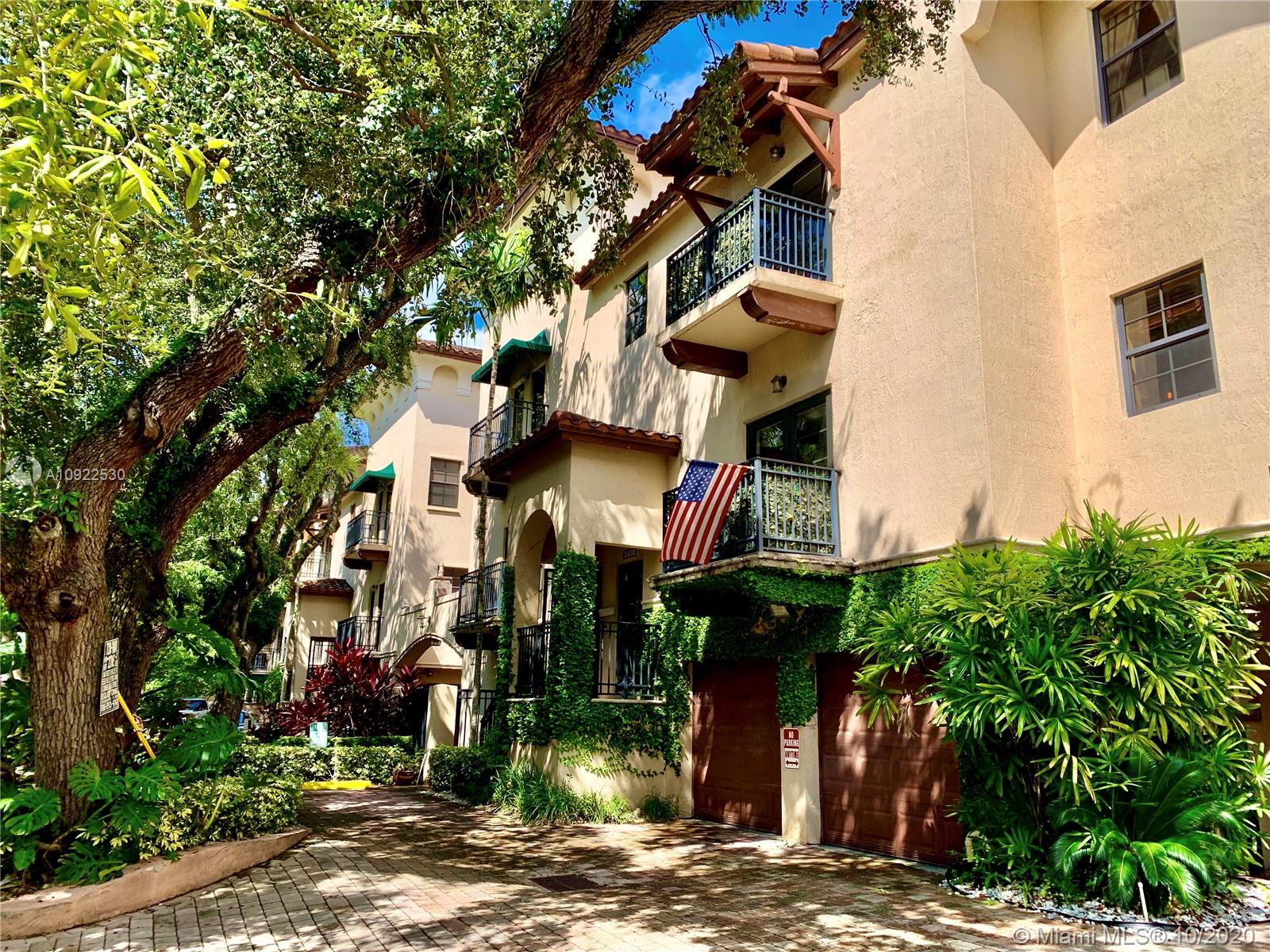 This immaculate, professionally decorated tri-level townhouse combines modern elegance and Mediterranean design. Unit features all impact glass, large 2 car garage, marble floors & spacious living area. Built in 2005, Villagio In The Grove is nestled in one of the Grove's most beautiful tree lined streets. Complex features exercise room, rooftop pool and chic courtyard. Enjoy true Grove living - walking distance to famous shops, restaurants & galleries. Pets ok, easy to show.