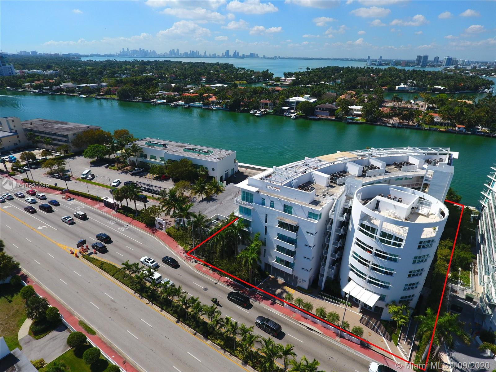 Gorgeous intercostal views of Miami Skyline. Very large balcony overlooking the water. This boutique building offers you everything you need. Open kitchen layout, spacious master, 2nd bedroom, ample closet space, plus den/office space, hurricane impact balcony doors, washer and dryer in unit. One assigned covered parking space. 1 block away from the ocean, walking distance to Publix, Walgreens, located right next to rowing club. Available immediately, Must see.