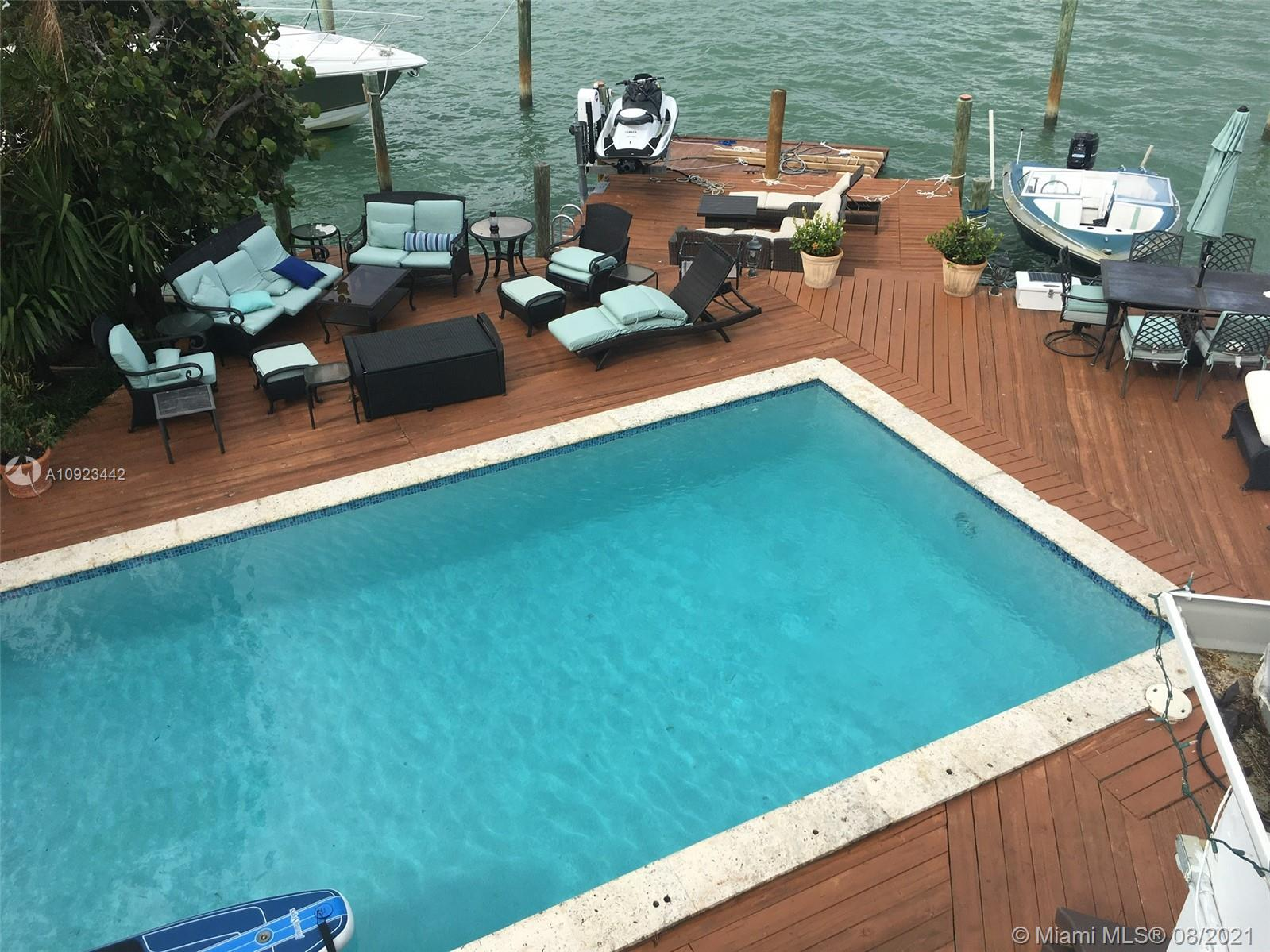 This 4/4 wide bay waterfront home with a dock, boat lift and jet ski lift has amazing wide bay view of sunrise, sunset, marine life, Indian creek Island and sits near the end of a cul de sac on Miami Beach's stillwater Drive. Paddleboard to sand bar in front of the house. Close to Bal Harbour Shops and South Beach. Walk to beach and jet ski or kayak to Haulover sandbar or around the island. Park for digs and kids at the end of the block.  Great location. Also available for rent at $12,500/month. May be rented furnished or not furnished.