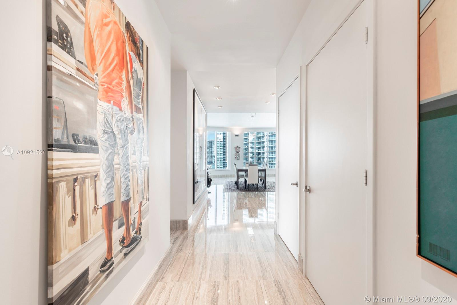 First time on the market for sale.  Located in luxury building Carbonell on Brickell Key this beautifully furnished unit completely upgraded, features 10 ft. ceilings,  3 bedrooms, 3. 5 bathrooms, marble floors throughout all common areas and wood floors in all bedrooms. Spectacular views of the City skyline, Port of Miami, Miami River and Bay from this most sought after corner unit Carbonell.  Carbonell offers five star amenities on this exclusive island.  Two parking spaces included.