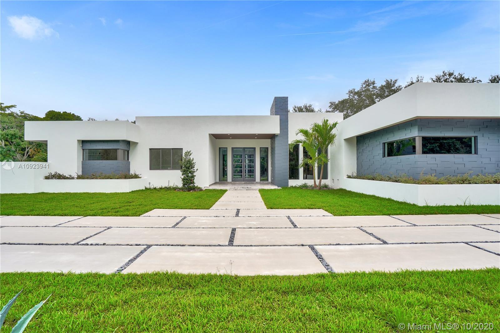 New Modern/Contemporary Home in Desirable North Pinecrest situated on a 34k SF corner lot W/ a total of 6880 SF of construction. This Luxury home showcases 6BR and 7.5BA with 5,422 SF of Living area. Featuring a Gourmet Kitchen W/ Miele Appliances, Great for entertaining or your private retreat with open floor Plan that flows directly to a huge terrace, Pool, Jacuzzi and Cabana area which includes outdoor summer kitchen. The Master Suite features grand entrance, 2 large walk-in closets w/ a stunning Marble bathroom, a soaking tub, double sinks, large shower, & private terrace. Living area has LED fireplace, Wine Cellar and is smart house ready. Maid's quarters, spacious 3 car garage w/ side entrance and large driveway for ample parking. No details overlooked in this Home, easy to show.