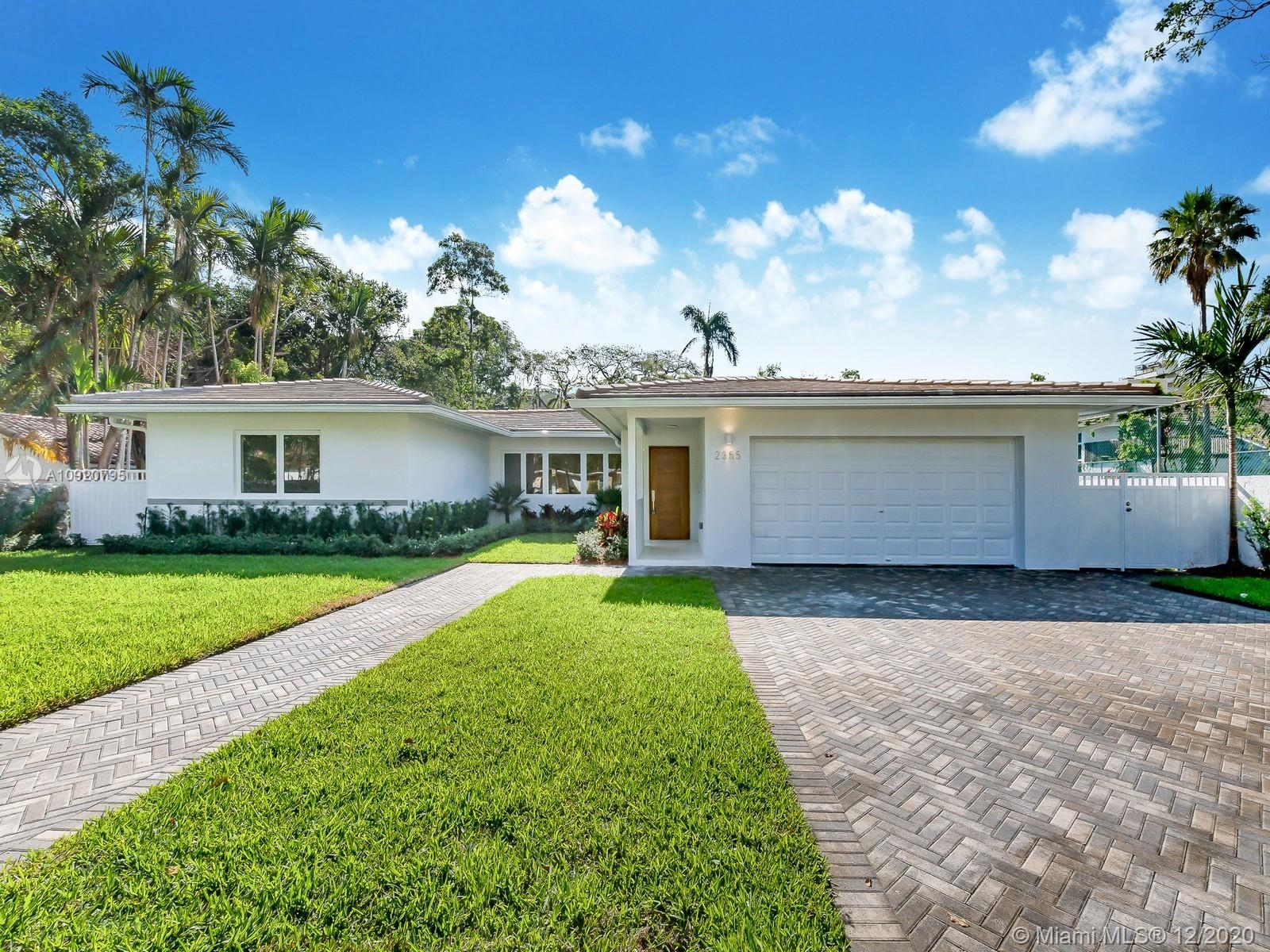 Located on the historic and luxurious South Miami Avenue, this flawless Mid-Century Modern home has been completely renovated with contemporary upgrades, while still preserving its original charm. Wood-beam ceilings in the family room; an open flowing layout with plenty of natural light, a new kitchen with custom cabinets, quartz countertops, and stainless-steel appliances; and a spacious covered outdoor patio are just a few of the features that make this 4 bedroom/4 bathroom home a rare find. At nearly 3,500 sf under AC, on a 12,750 lot with large manicured yard that would easily fit a pool, this is an ideal home for a family wishing to be in the heart of Miami.  Walk or bike to Brickell, downtown, or Key Biscayne, and  enjoy the atmosphere of one of Miami's first and finest neighborhoods