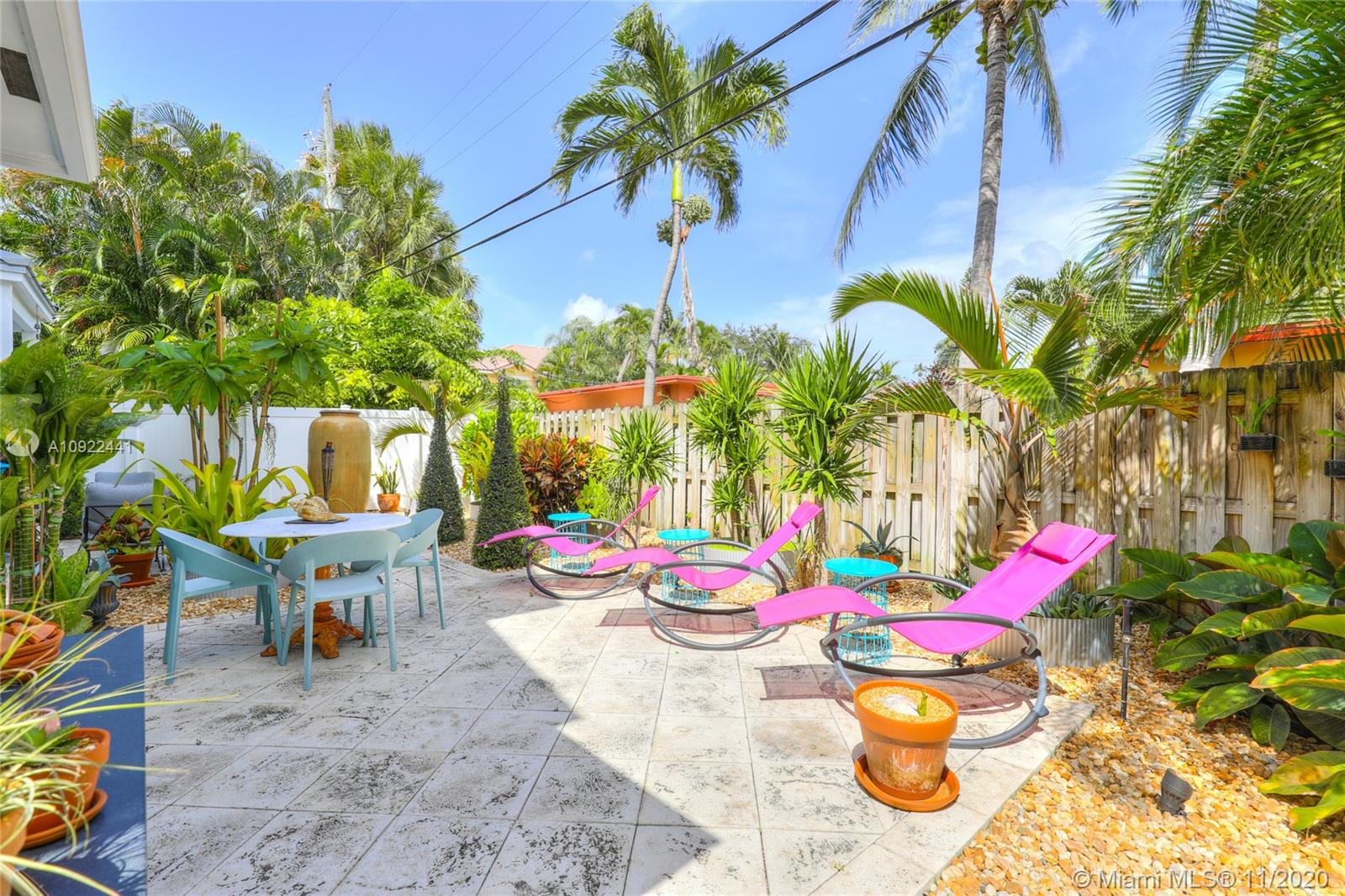 Key West style luxury townhouse walking distance to the Galleria Mall, beach, and a short drive to Las Olas and Wilton Manors. This newly landscaped end unit with a 2 car garage gives you lots of privacy. There are three ensuite bedrooms including one on the first floor perfect for visiting guests. The open living area and large kitchen with high-end appliances are great for entertaining. All flooring is Italian marble with wood flooring in staircases! Lots of light from windows and balcony and lots of upgrades! Private backyard for your pet!