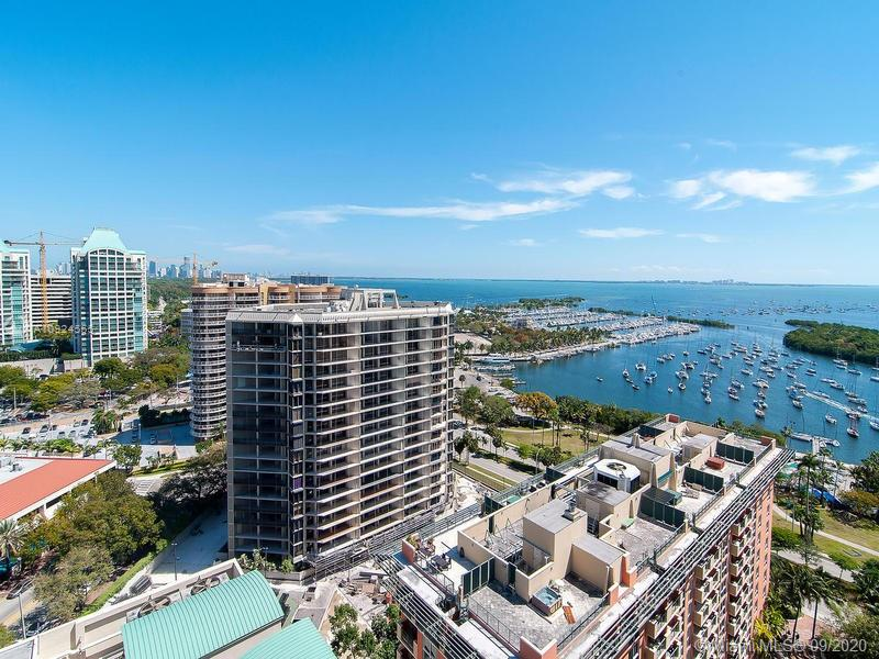 Extreme Rare opportunity to aquire  sought after  studio condo no rental restrictions in condo Hotel with all amenities including pool, fitness center,cafe, bis center, 2 squash courts, 24 hour security, front desk and walk to all coconut Grove parks,sailing,restuarants and the new coco walk. This studio has a newer tile floor and paint. Balcony has captivating views of Biscayne bay, parks and views of Miami. Floor to ceiling sliding doors. Furnished and ready to be your Piedaterre in beautiful Coconut Grove or perhaps an income producing rental unit.....