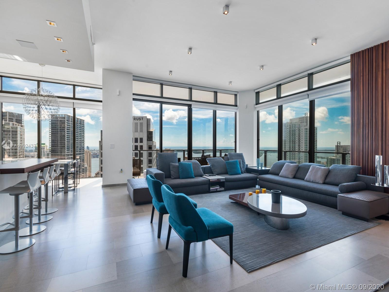 The Residences - Reach at Brickell City Center, include an elite collection of corner units featuring soaring ceilings, floor to ceiling sliding glass doors, a half-acre amenity deck, interior elegance from the lobby to the units make this building unique for the ultra-luxury connoisseur.   This, 4B/4.5B, 4101 unit is equipped with Magnolia@ smart equipment, Hunter Douglas top of the line window treatments, Lutron, whole home audio, lighting controls, upgraded kitchen appliances, Carrara marble upgraded kitchen counters & backsplash. Everything in this home in the sky is completely automated w/maximum speed wireless internet everywhere.  A modern designed has been completely executed by the philosophy of the Salvioni Network, where every piece of furniture & art has been carefully selected