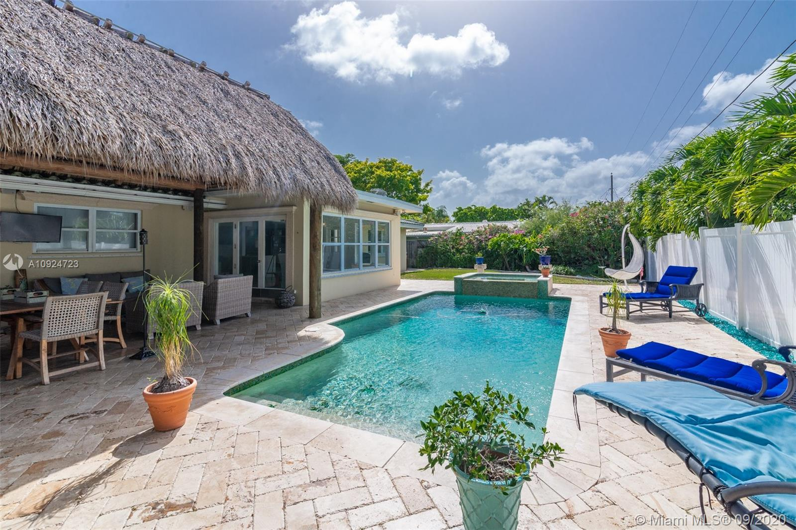 Perfect opportunity to own your piece of paradise in The Cove! This 2/2 has an open concept design with lots of natural light, retraso floors all throughout home, modern kitchen with wood cabinetry and stainless steel appliances, master bathroom has been upgraded to all white subway tiles and black appliances, office/storage space including the laundry room that could also be utilized as a one car garage. Enjoy the feel of the tropics in your backyard with the pool, spa jacuzzi and Tiki Hut perfect for entertaining guest!