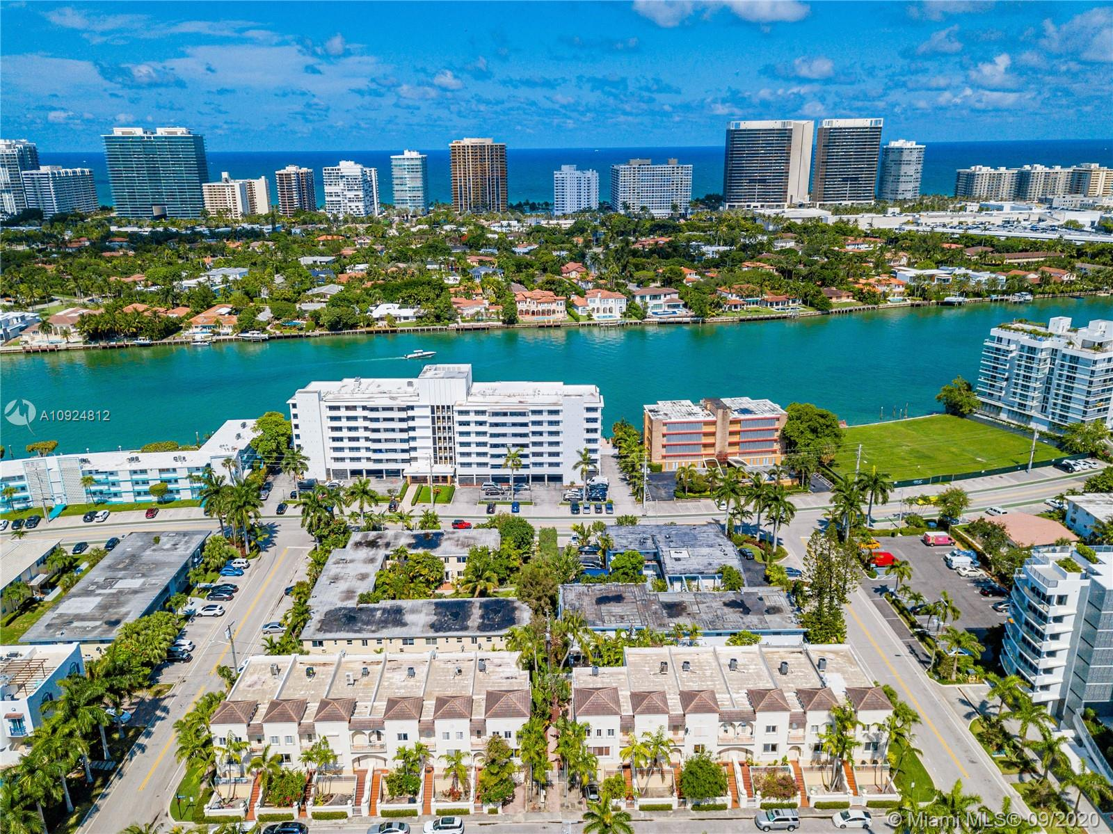 Spectacular and spacious 5 bedrooms 3.5 bathrooms townhouse located in Bay Harbor Islands. Townhouse is 3 floors with 3 bedrooms upstairs, living area on second floor and 2 bedrooms on first floor. Large living area , 2 car garage, community pool. Master bedroom with large walk-in closets and dual sink bathroom with bidet. Entire second floor consists of kitchen and living room. New water heater and 2 AC units , 4 years old, new roof. Maintenance fees includes : water, sewer,trash, exterior maintenance, roof. Minutes to Bal Harbour Shop's, Fine Restaurants , famous Ruth K Broad Bay Harbor K- 8 school, places of worship and the Beaches,children parks and dog parks.