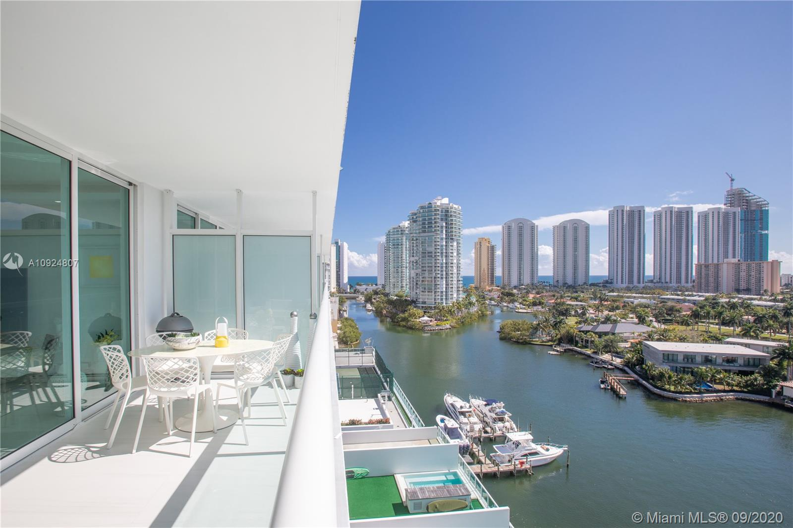 A perfect admirable exclusive apartment for sale at 400 Sunny Isles. This fantastic and unique apartment offers one of the most beautiful views in Miami. It is a south exposure with east and west views! Great sunrises and sunsets. It can be sold furnished/negotiable. A flow-thru floor plan exposes this amazing unit to several views! 3 bedrooms and 2 1/2 baths. 3 assigned parking spaces. 2 storage rooms. A very spacious living area with a great balcony. Just a block from the beach. A private marina is available! Kitchen with quartz countertops, wine cooler, italian porcelain floorings and walls. Lots of storage. Building has fantastic amenities like beautiful pool with bar, sauna, jacuzzi, tennis courts, spa, gym, 24 hr concierge and security