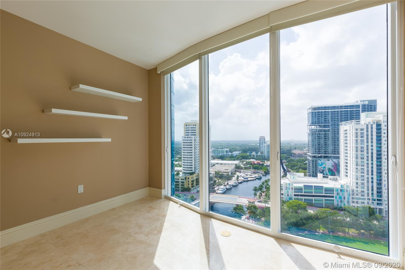 Welcome to your perfect urban riverfront home in Ft Lauderdale's landmark tower.  Located on the New River in the heart of downtown & famous Las Olas Blvd. This special 2/2.5 offers huge views from every room showcasing the vibrant New River, Riverwalk, tropical pool deck, city park and city skyline. Round radius floor to ceiling glass plus large balcony with over 240 sq ft makes this lovely condo a very unique property.  Elevators sweep you to your semi private foyer on the 22nd floor. Enjoy River House's 5 Star lifestyle with 24 hr valet, concierge, huge lobby with Koi ponds, world class fitness center, party rooms and tropical pool deck. $4M renovation underway with no assessments!! New hotel with 2 restaurants and Greenwise grocery store right outside the front doors! Urban+fun!