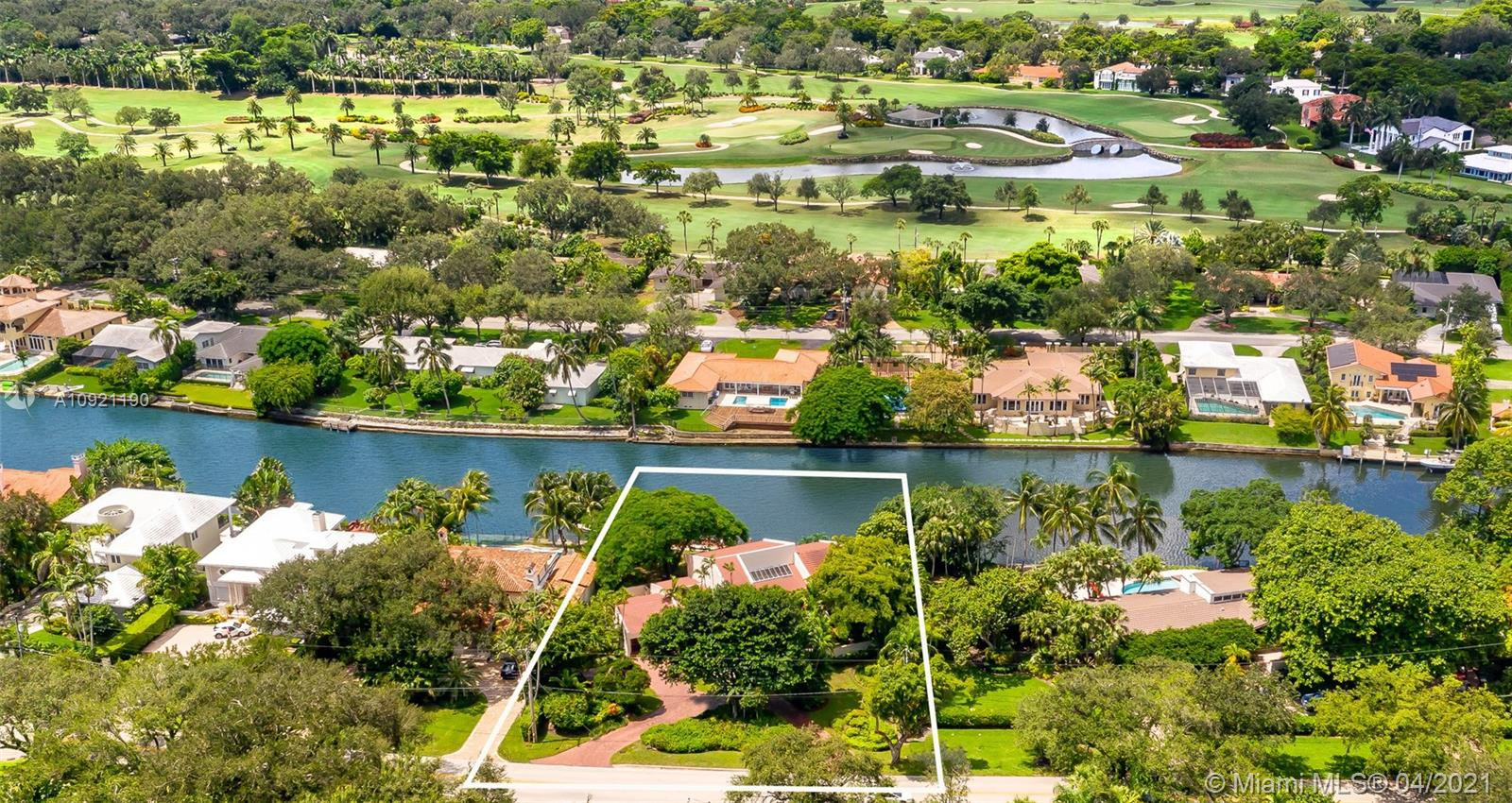 Golden Opportunity to buy a one of a kind WATERFRONT home in the heart of Coral Gables. Few houses enjoy such a privileged position on one of the widest sections of the sought-after Gables Waterway w/direct access to Biscayne Bay. This contemporary home is bursting with potential as it lies on a lush 18,872 SF Lot, including 125' of water frontage with dockage and a custom-built concrete sea wall. Offering over 5,000+SF, this home features a sun-soaked interior central patio, large family room with billiard table ideal for entertaining, spacious kitchen with abundant storage, formal living/dining rooms, large office, service/in-law quarters, expansive master suite, and spacious backyard with huge potential. This property offers unlimited opportunities to be your dream waterfront home.