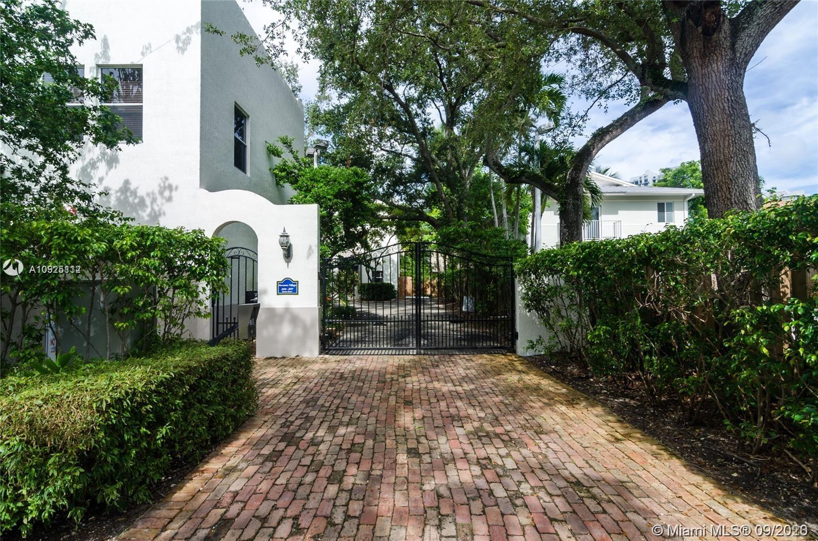 RENOVATED TOWNHOUSE IN GATED PROVENCE VILLAGE; A BOUTIQUE, PRIVATE ENCLAVE IN CENTER GROVE WITH REMOTE GATED ENTRY. INTERIOR UPDATES INCLUDE KITCHEN,BATHS, FLOORING AND 2ND FLOOR VAULTED BEDROOMS, EXTERIOR FEATURES INCLUDE PRIVATE REAR PATIO & GARDEN PLUS 2 PRIVATE ASSIGNED PARKING SPACES AT YOUR FRONT DOOR.  SHORT WALK TO SHOPS, RESTAURANTS, CAFES AND ASSIGNED PARKING SPACES AT YOUR FRONT DOOR.  CENTRALLY LOCATED CLOSE TO BRICKELL/DOWNTOWN MIAMI, CORAL GABLES, BAY AND BEACHES. GREAT TO LIVE OR INVESTMENT.