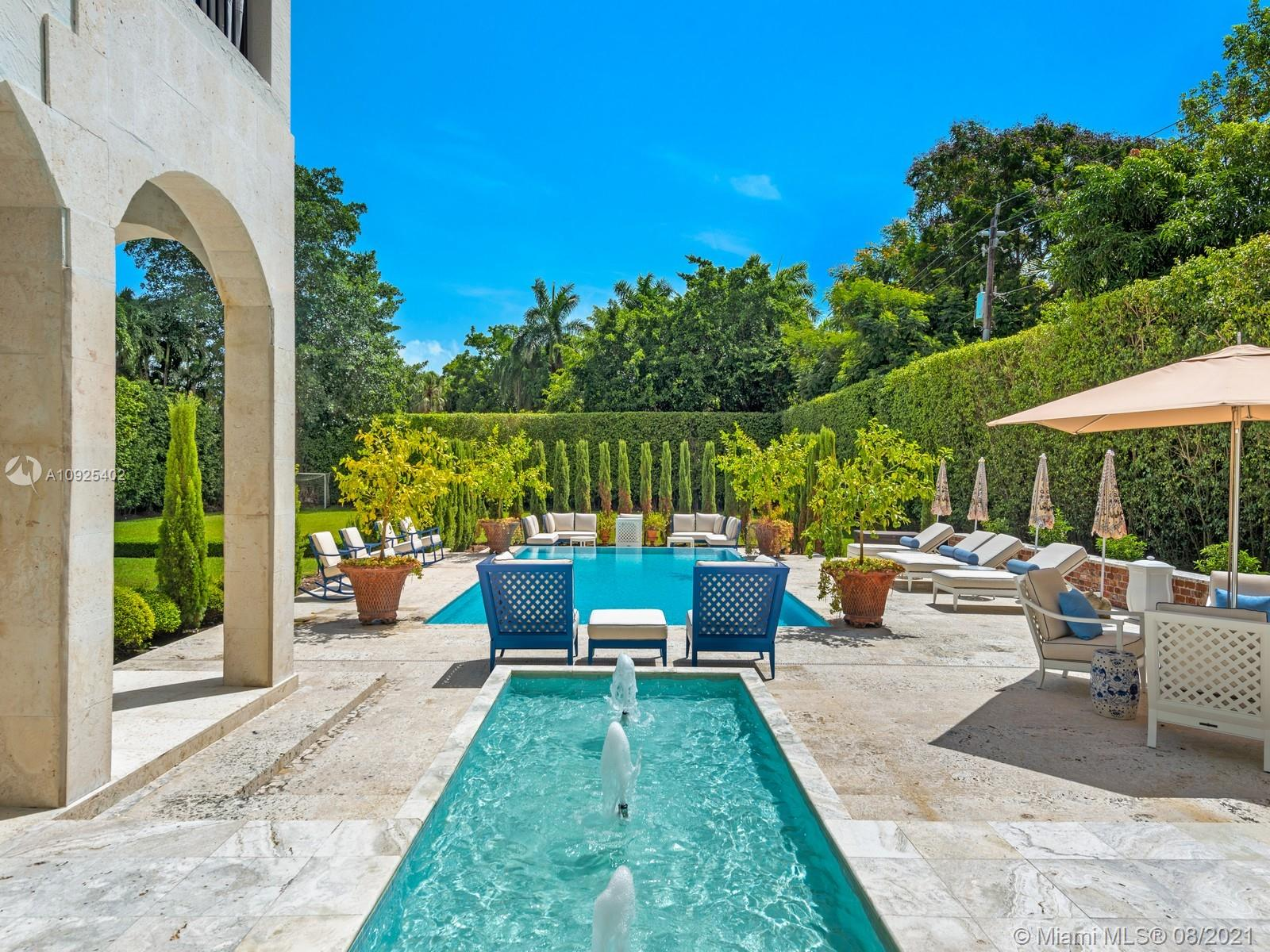 Extraordinary GATED home ideally located in the coveted area of PONCE DAVIS. Minutes from Miami's best schools this ONE ACRE property is the ideal family home filled with character & charm.This 8,322 SF home offers 6 beds,7.1 brand new baths in a desirable layout generously spread across two levels.Ground floor features recently updated oversized gourmet kitchen w/double islands,top of the line industrial walk in fridge&freezer+Wolf appliances,this kitchen is a Chef's dream,formal &Informal living+dinning rooms,guest suite,service quarters & more!Upstairs offers master suite w/oversized walkin closet,updated master bath & a terrace overlooking the grounds+3 additional beds w/ensuite baths &walkin closets.W/beautiful landscaped gardens,edge pool &full bbq,this home is an entertainers dream!