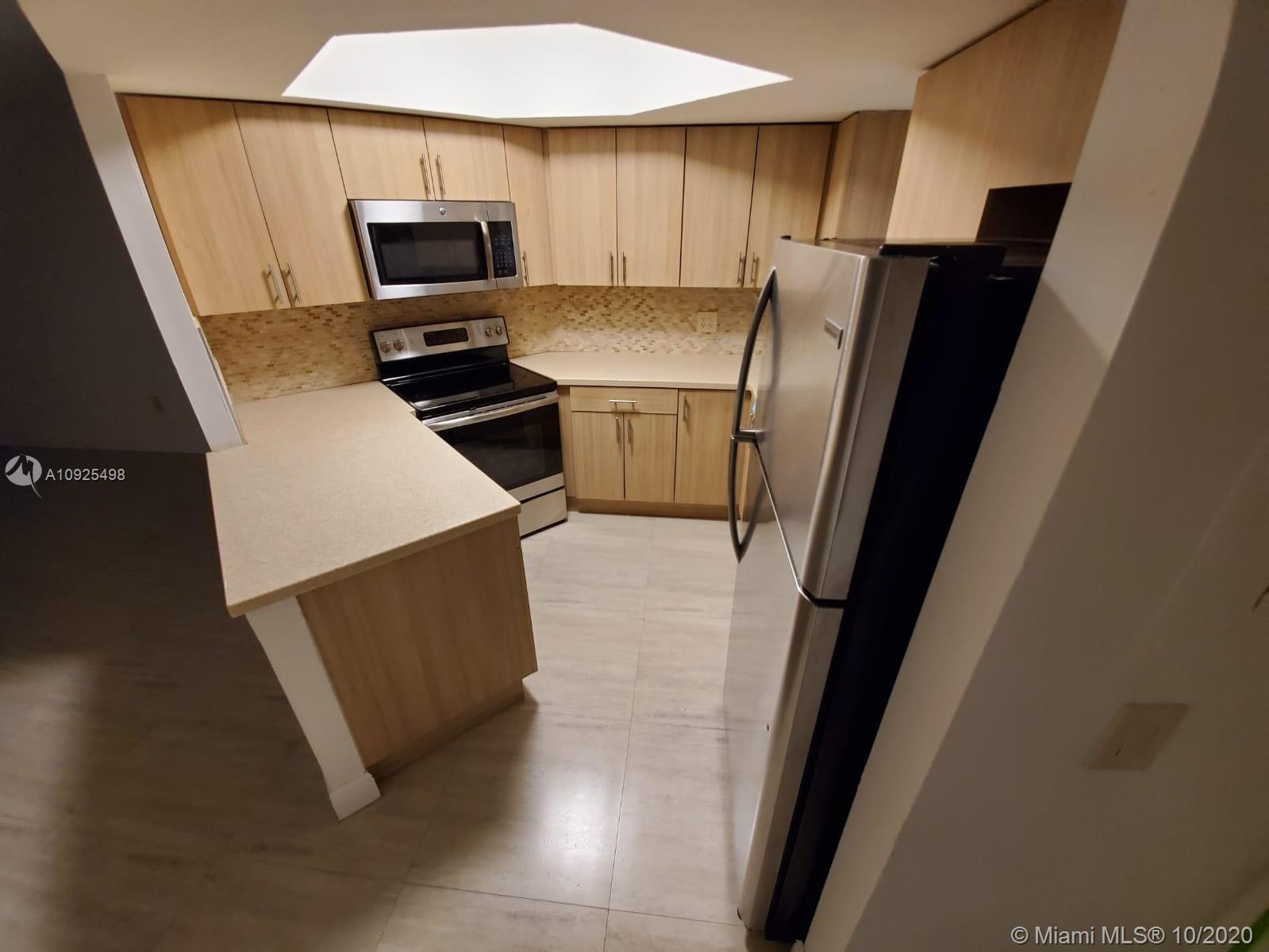 Totally Up Dated. Amenities include 4 pools, gym, tennis and racquetball courts, 24 hour security, up to 2 parking spaces. Centrally located community, walking distance to Downtown Doral, short distance from the airport and main highways. FIRST MONTH and ONE MONTH DEPOSIT!!!