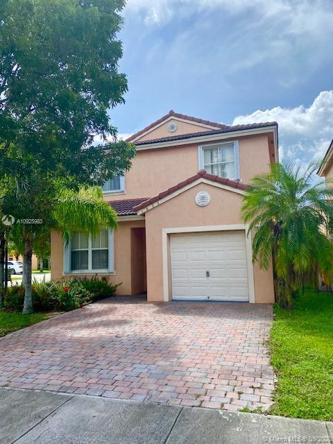 Perfect starter home! Corner home, 3/2.5 with 1 car garage in the lovely Shores gated community. Home features a spacious open floor plan, tile on 1st floor, accordian shutters and great sized yard for entertaining.