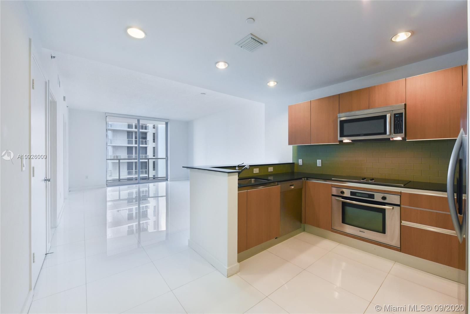 AVAILABLE OCTOBER 7TH! Spacious 945 sq. ft. unfurnished 1 bedroom/1 bath with a terrace and white tile