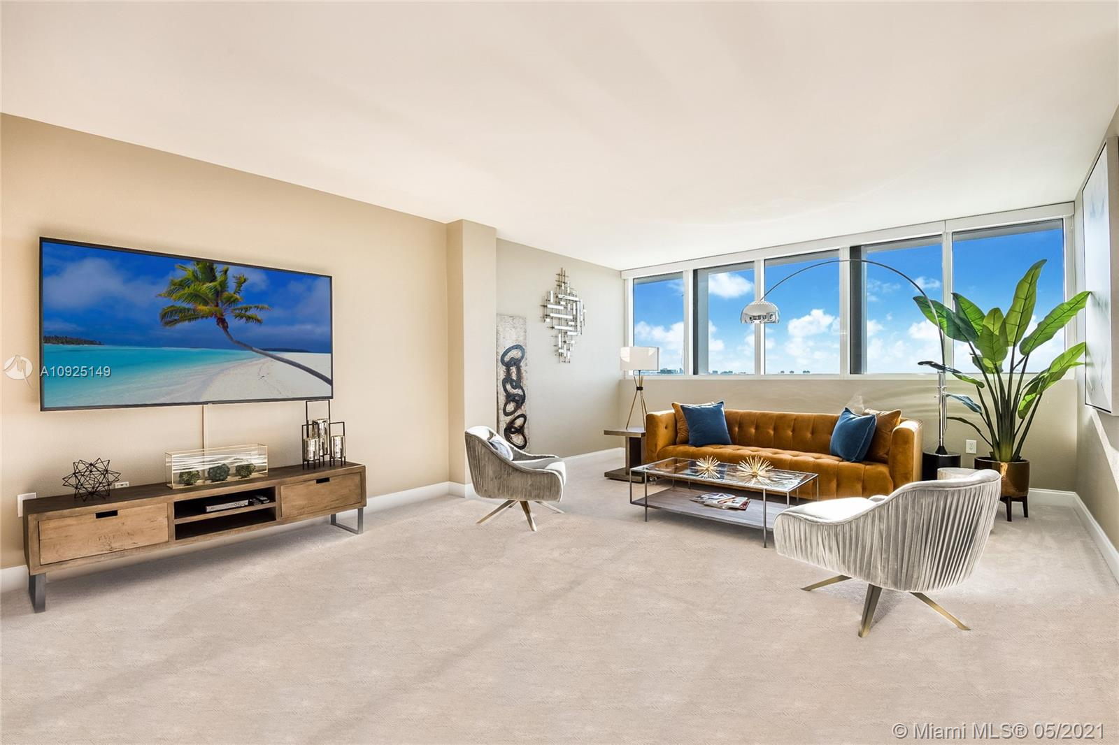 Gorgeous, newly furnished modern penthouse in full-service 5-star luxury building with views to match! Rare opportunity to own in prime location near Bal Harbour Shops, next to The Ritz-Carlton. Designer decorated showpiece with large open floor plan, boasts two large masters with oversized closets, wall to wall windows with expansive water and city views, new non-toxic paint, new carpet, marble floors, new stainless appliances, new doors, new bathroom countertops and fixtures, touch activated lighted mirrors, new kitchen fixtures, new lighting, washer/dryer, energy-efficient features, artistic and custom touches throughout, and huge double balcony.