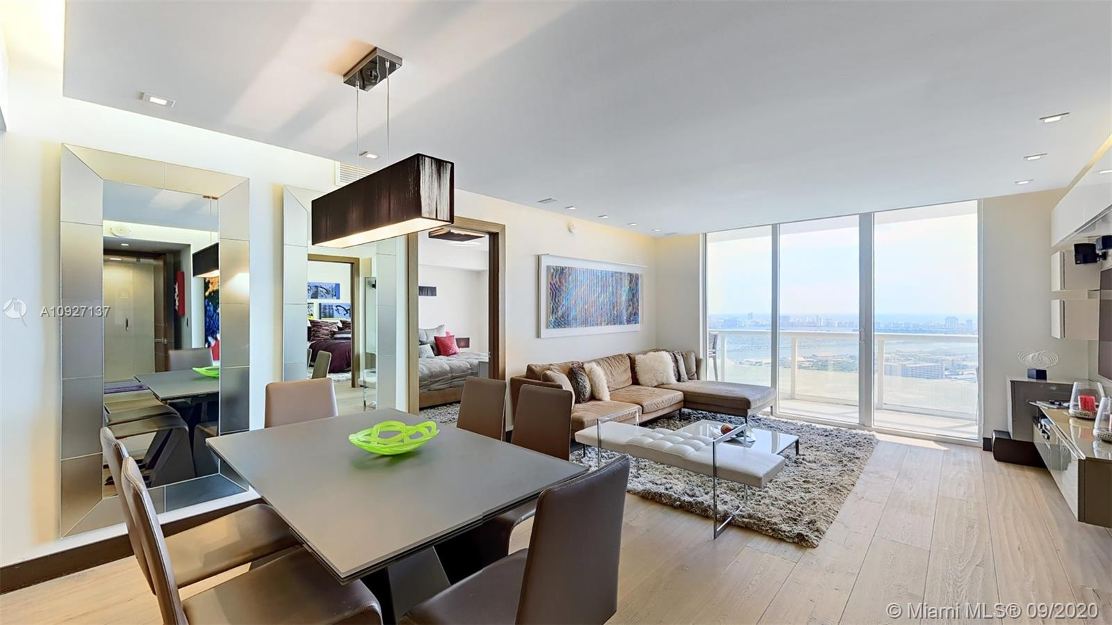 This stunningly upgraded residence features direct unobstructed views of Biscayne Bay and Miami Beach that will greet you as soon as you step in! A masterpiece of design with attention to details, this unit has spectacular views of Biscayne Bay and the City from every room!
