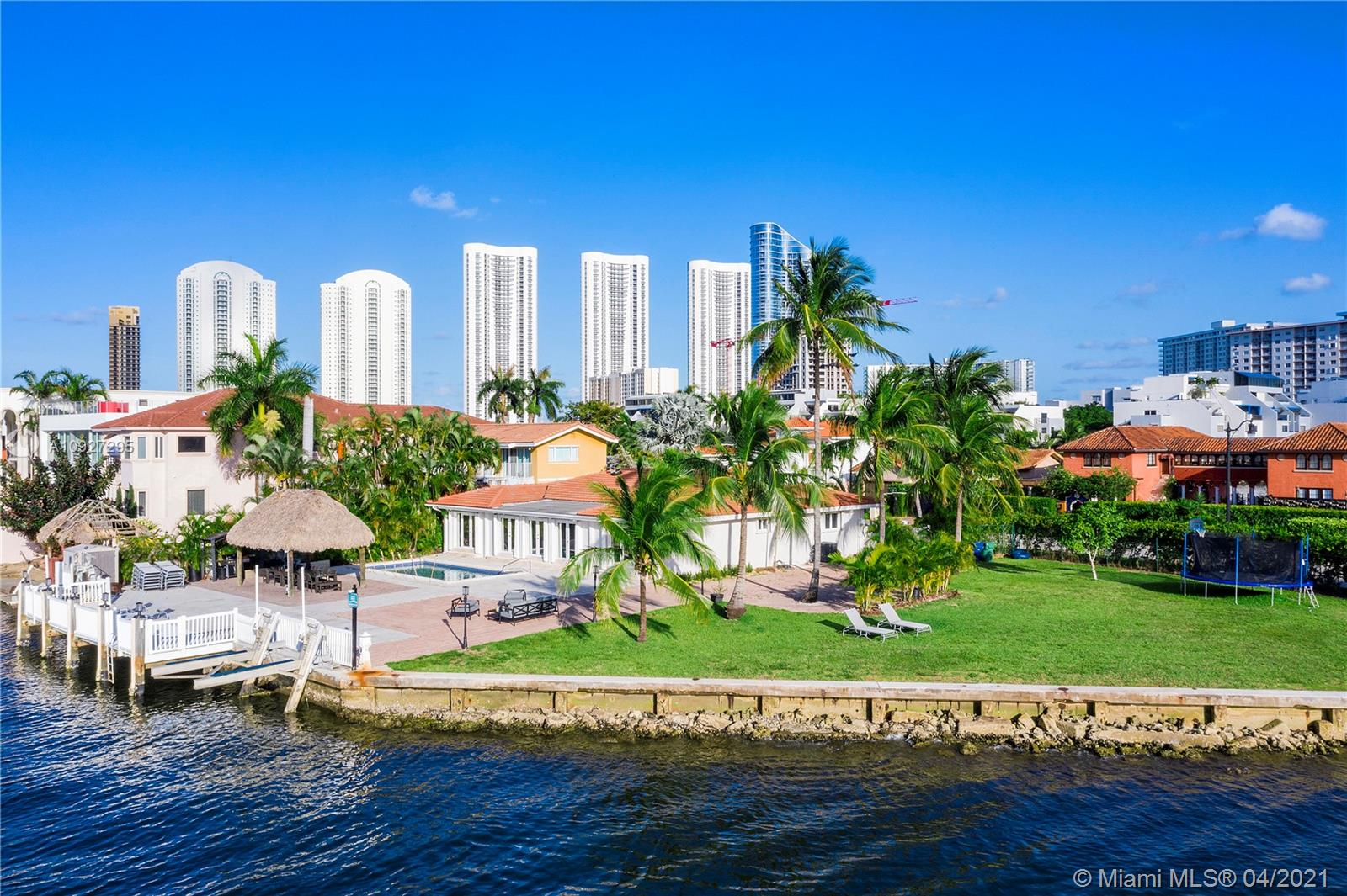 21000 SQF  POINT LOT WITH 250 LINEAR FT OF WATERFRONTAGE!!!! ORIGINALLY 2 LOTS COMBINED INTO ONE, PROBABLY ONE OF THE BEST LOTS IN SOUTH FLORIDA !!!   PRIVACY  AND UNOBSTRUCTED VIEWS FOREVER.  THE HOUSE HAS CLOSE TO 3000 SQF , OPEN FLOORPLAN WITH VIEWS FROM EVERYWHERE, HOWEVER THE POSSIBILITIES ARE ENDLESS TO BUILD YOUR CLIENT'S DREAM MANSION.