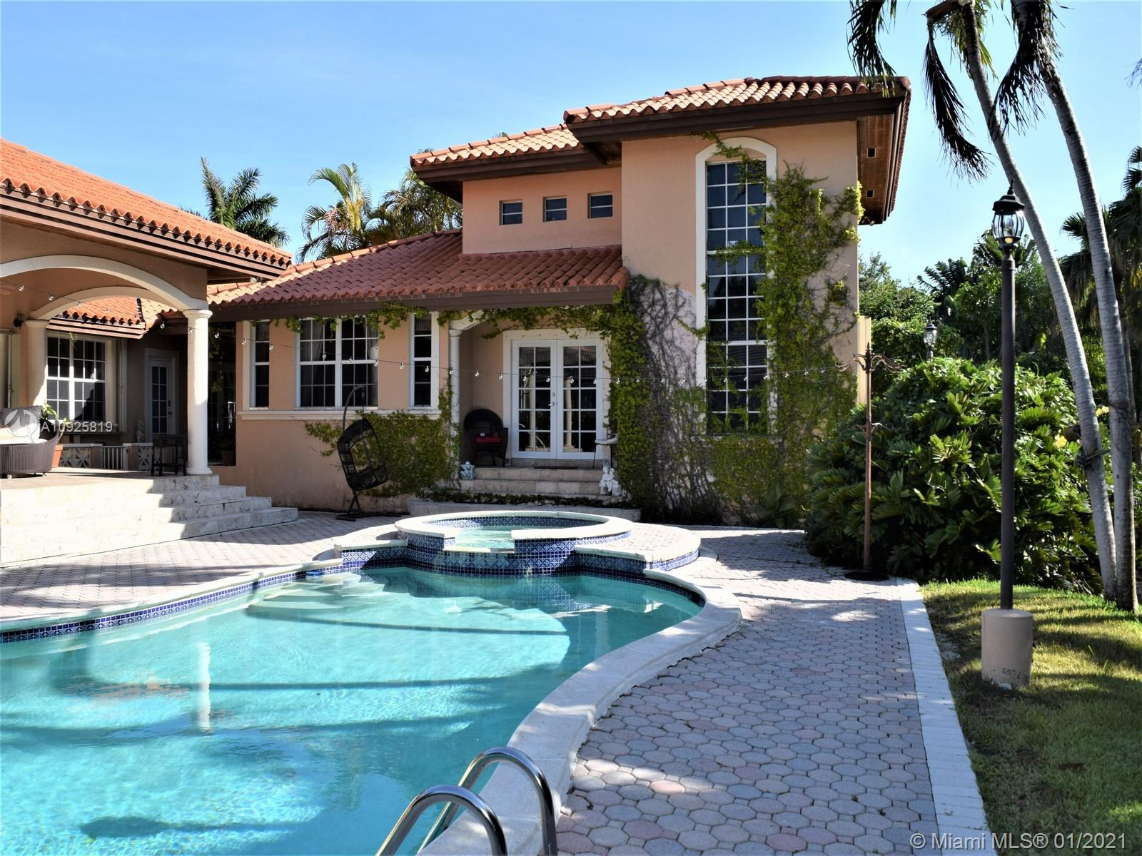 Tucked away in the exclusive gated waterfront community of Cocoplum, conveniently close to Coral Gables, South Miami, Coconut Grove, and Biscayne Bay, this spacious contemporary Mediterranean-style home was built in 1996 for elegance an comfort. Set on a lushly landscaped 16,988 sf lot-the 5-bed/4.5-bath open layout home boasts an impressive entry foyer, large formal living room, an updated kitchen with stainless steel appliances, and formal dining room all ideal for entertaining. Outside, the beautiful backyard includes a lovely swimming pool as well as a two-story guest house/in-law suite with bar, full bath, and upstairs bedroom. Additional extras include a two-car garage, separate laundry room, and great central community location