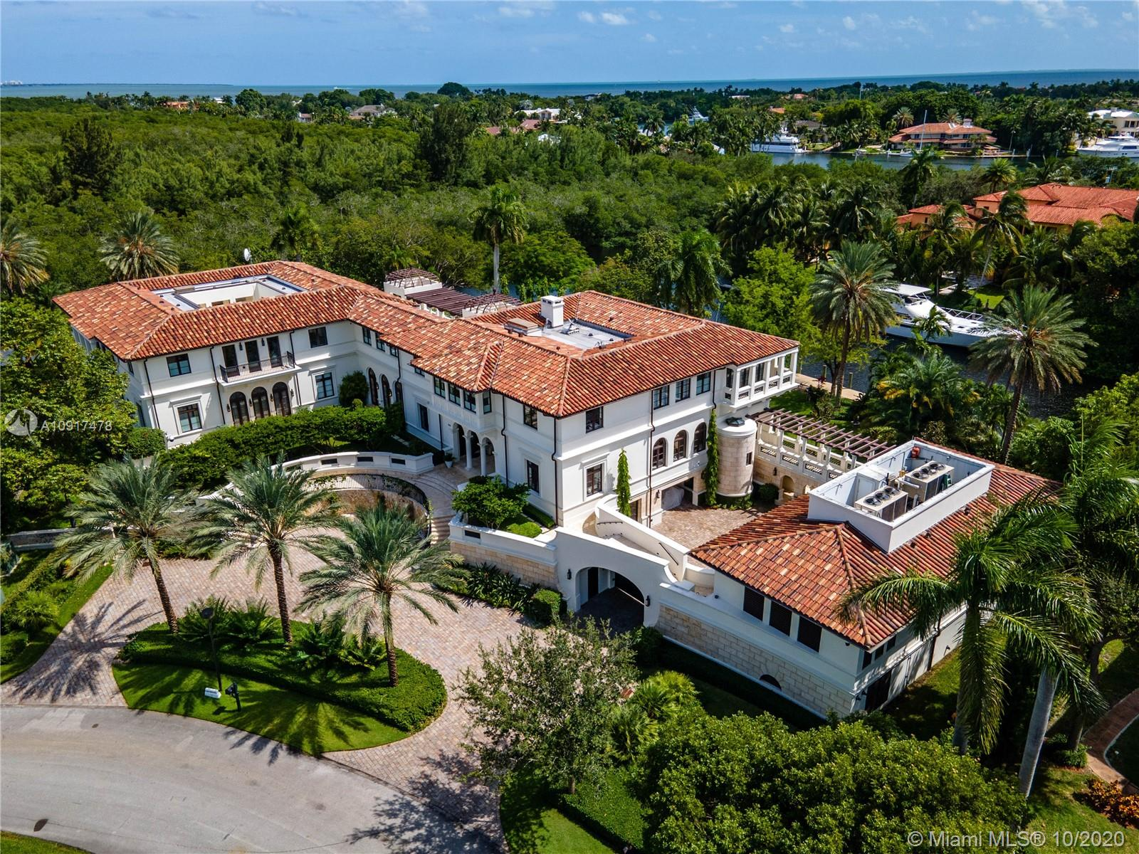 One of a kind opportunity to leave in Villa Costanera on desirable Islands of Cocoplum & Coral Gables waterway. This Amalfi coast inspired masterpiece offers 20,546 sq living space & sits on 1.3 acres corner lot with 480' water frontage & dock with ocean access, 12 bedrooms, 13 full bathrooms, 2 powder rooms, commercial elevator, custom crafted italian kitchen + butler's pantry, huge master suite with his/her bath, expansive terraces, fabulous views of garden and waterway, 2 kitchens, wine cellar, separate guest/staff quarters, outdoor entertainment area + summer kitchen, covered terraces, heated pool & so much more. Unique architecture by renowned architect Rafael Portoundo allows natural light to radiate throughout every room. Will exceed your expectations!