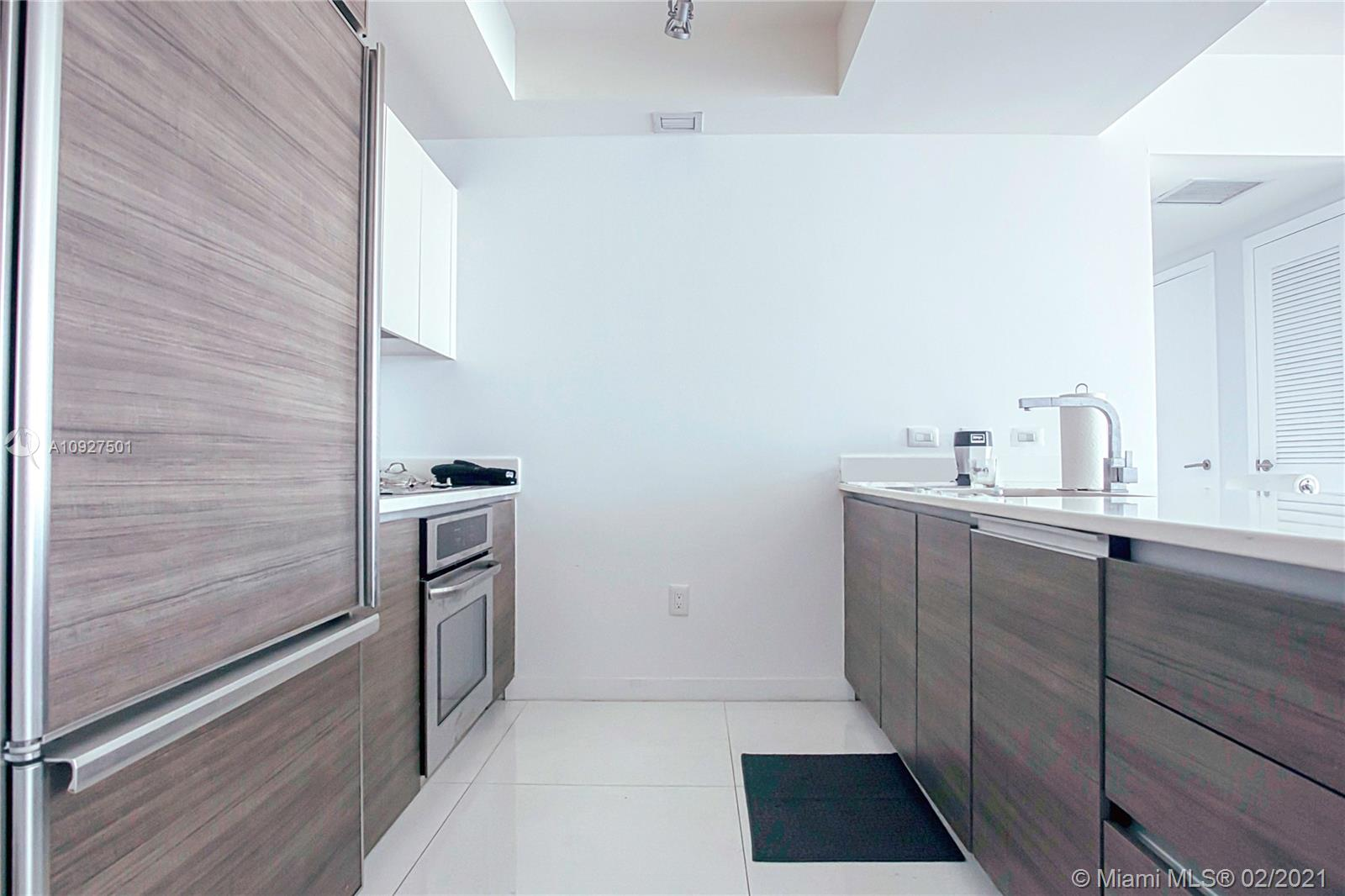 Come live in a completely upgraded Spacious Studio in the heart of the Brickell City Center and walkable to retail, restaurants, and the train. The unit boasts High Ceilings, California Closets, Tile throughout, Tiled Balcony, Glass Shower Enclosure, TV Wall Mount Electrical hook-up, Rolling Blackout Shades, Curtain Rods, Recessed Lighting, Bedroom Privacy Divider, and modern Italian cabinetry throughout. Millicento by Pininfarina is an elegant and luxurious boutique high-rise with full amenities. Come take in the views from the Roof Top Skyline Pool, bask in the lower shaded pool, work/study in the many well-designed sitting areas, enjoy the theatre, gym, cardio room, yoga room, an indoor playroom for the kiddos. 24-Hour Security. Parking space included.