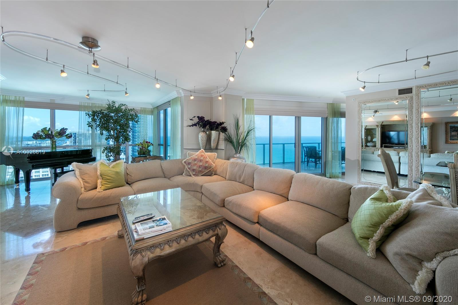 Spacious 3,466sf 4 bed/3.5 bath flow through condo with Ocean & Intracoastal views from every room. No detail has been overlooked. Professionally decorated with all the finer finishes. 2 parking spaces. 5 star amenities.