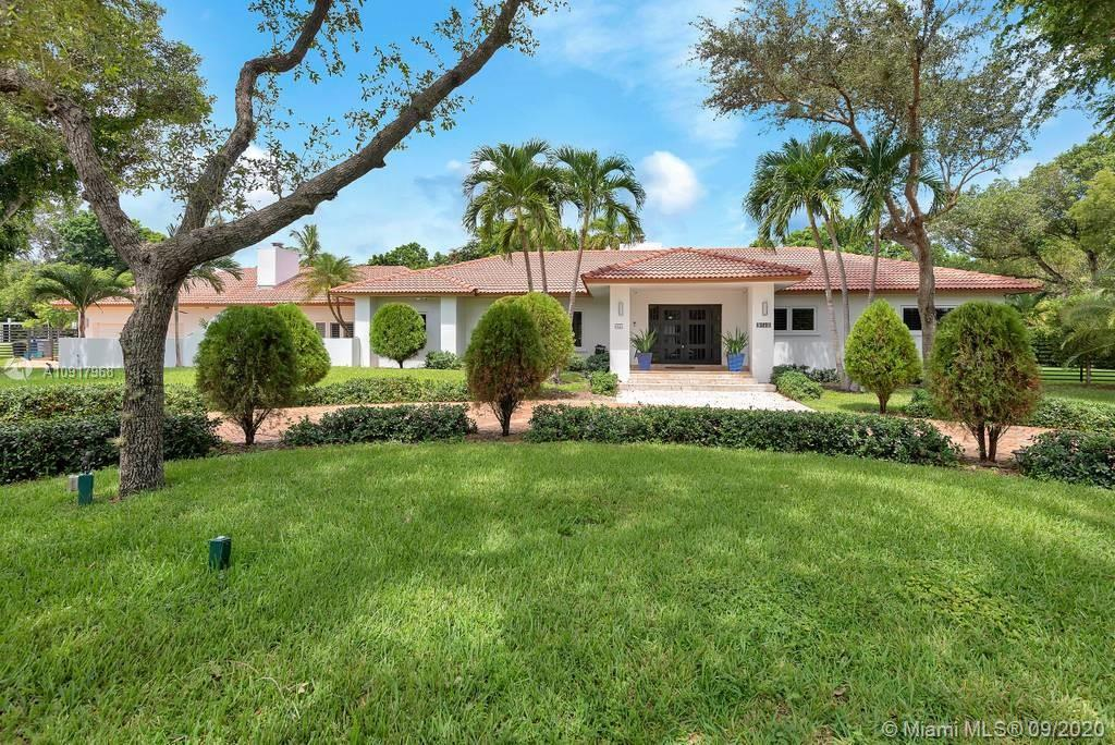 Spectacular Estate located in the heart of Pinecrest. Perfect home for family and entertaining located near top rated public and private schools. Enter into a beautiful open foyer facing large fireplace. 6 bedrooms, 5 bathrooms. One story split floor plan with oversized master & 3 additional bedrooms on one side of the home, 2 additional bedrooms on the opposite side. Marble floors, Brazilian cherry wood floors in bedrooms. Granite kitchen with stainless steel appliances. Two fireplaces, terraces covered in Jerusalem stone surrounding the perfect pool. Impact windows and doors throughout.Plantation shutters throughout. Spacious open floor plan. Circular paved driveway with 2 car garage including additional storage room and separate laundry room.
