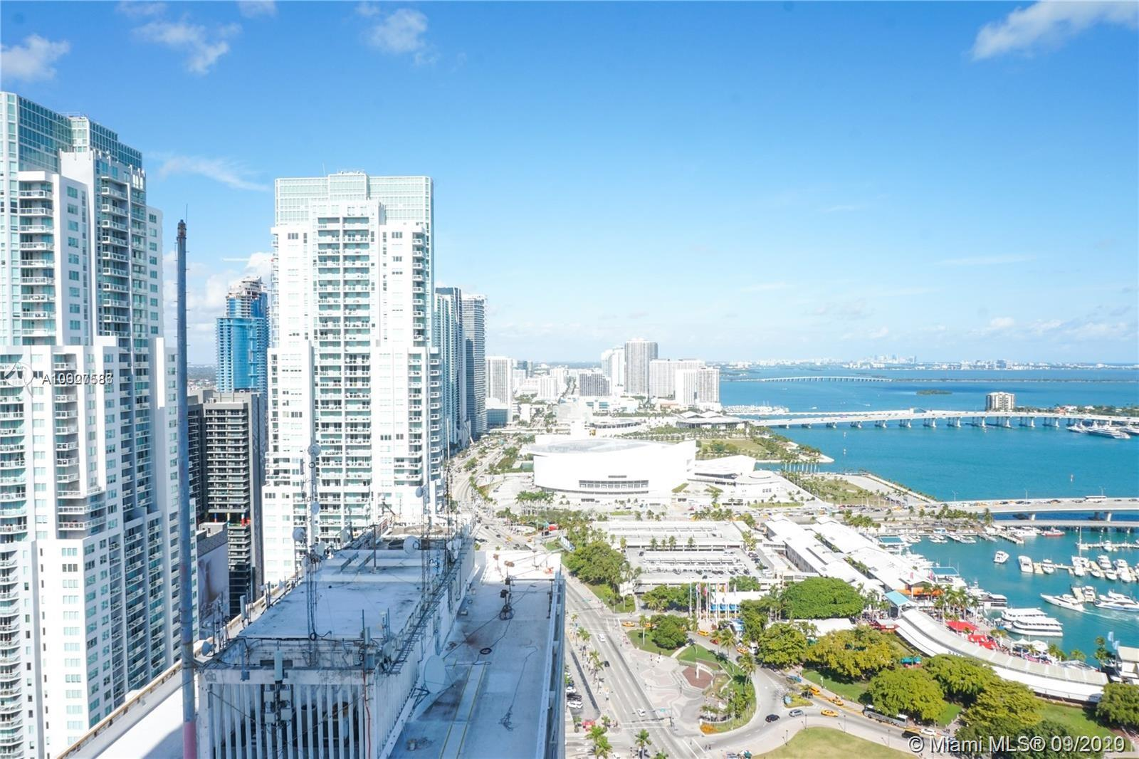 Best priced corner 3/2 with wrap around balcony in Downtown Miami. Unobstructed views to the North, East, and South. Largest unit line in the building. 3rd bedroom can be used as an office or bedroom as there is a walk in closet and bathroom. All bedrooms have access to balcony as well as three access points in the living room. The washer/dryer and ac unit are hidden in utility closet. Apartment comes partially furnished with beds, living room, and dining room. All this unit needs is a little personal touch and the right tenant! easy to show, call listing agent