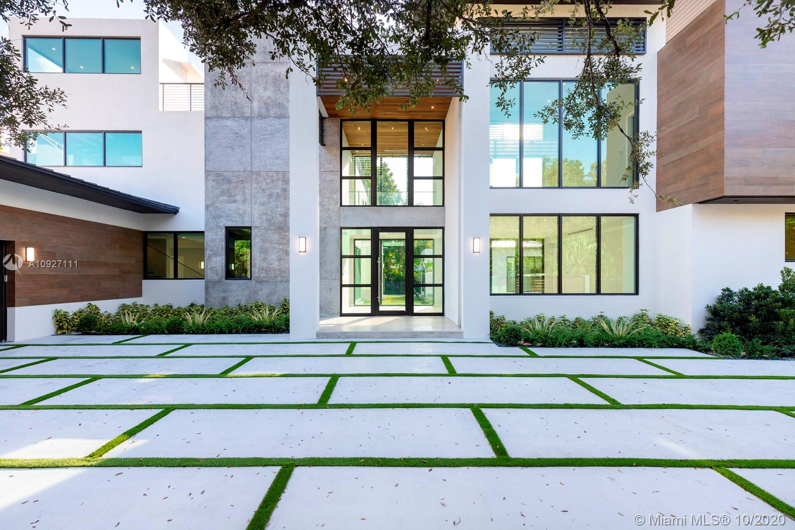 A perfectly-crafted, modern new construction home in the heart of South Miami's High Pines neighborhood. This 6/7.5 home has it all: a spectacular entryway with a 10-ft door and 10+ft ceilings throughout the first floor; a grand, open kitchen with custom cabinetry and appliances from Mia Cucina; impeccably-designed bathrooms and custom closets; an elevator; rooftop deck with summer kitchen; smart-home technology throughout; and a dedicated home gym with sauna and steam rooms. The home is centered around a resort-like pool that can be seen from almost every room in the house. Incredible construction and a prime location make this an unparalleled offering.