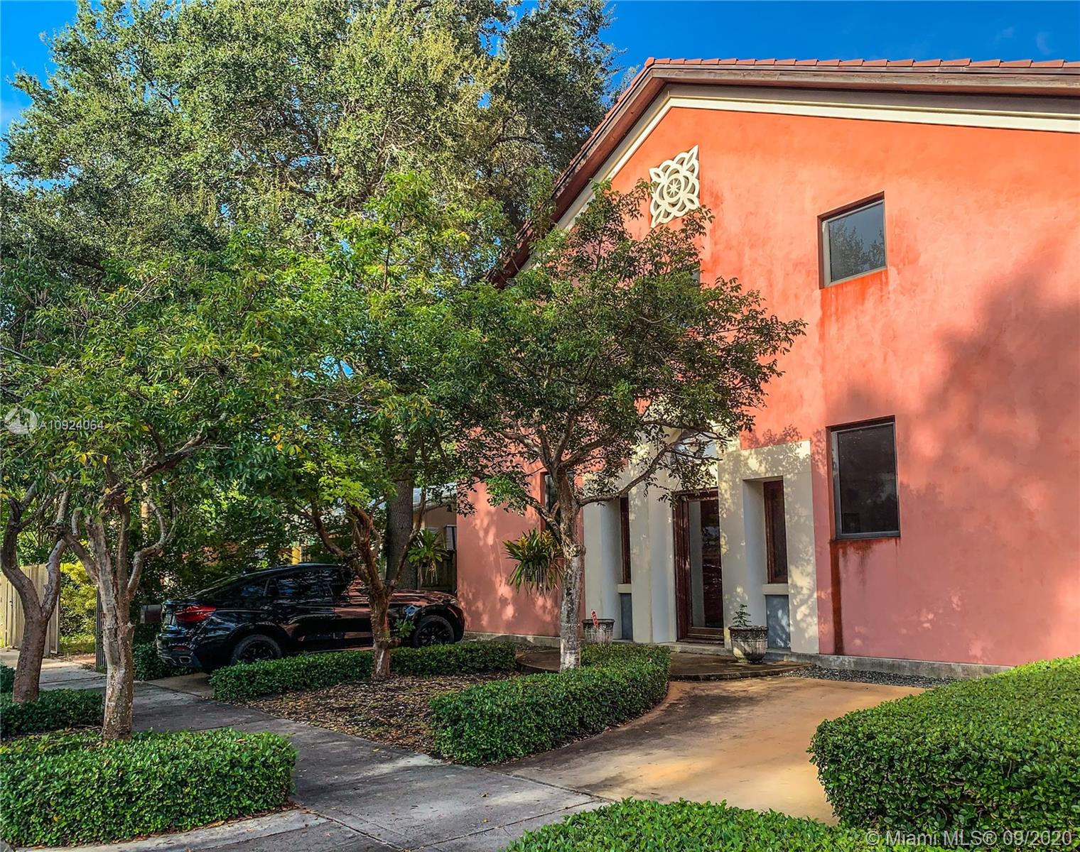 **CHECK BROKER REMARKS** FOR SOPHISTICATED BUYERS! Award winning Tuscan villa designed by renowned architectural firm Trelles-Cabarrocas. National Award for Classic Architecture 2012 AIA (See award in attachments) . Formal living spaces & downstairs master bedroom. Open onto covered loggia & the gardens beyond. Unique features include 12 ft. ceilings, upstairs wooden family room, Murano blown-glass light fixtures, custom mahogany cabinetry w/stained glass, oil-rubbed yellow pine wood paneling, and closets, stained & polished concrete floors and an expansive attic/storage space at the top. Very fresh during the heat of the summer months. Minutes from downtown Miami & the Grove Village. A few blocks away from Grove's Parks and Marinas, 10 minutes away from the Airpot and from Key Biscayne.