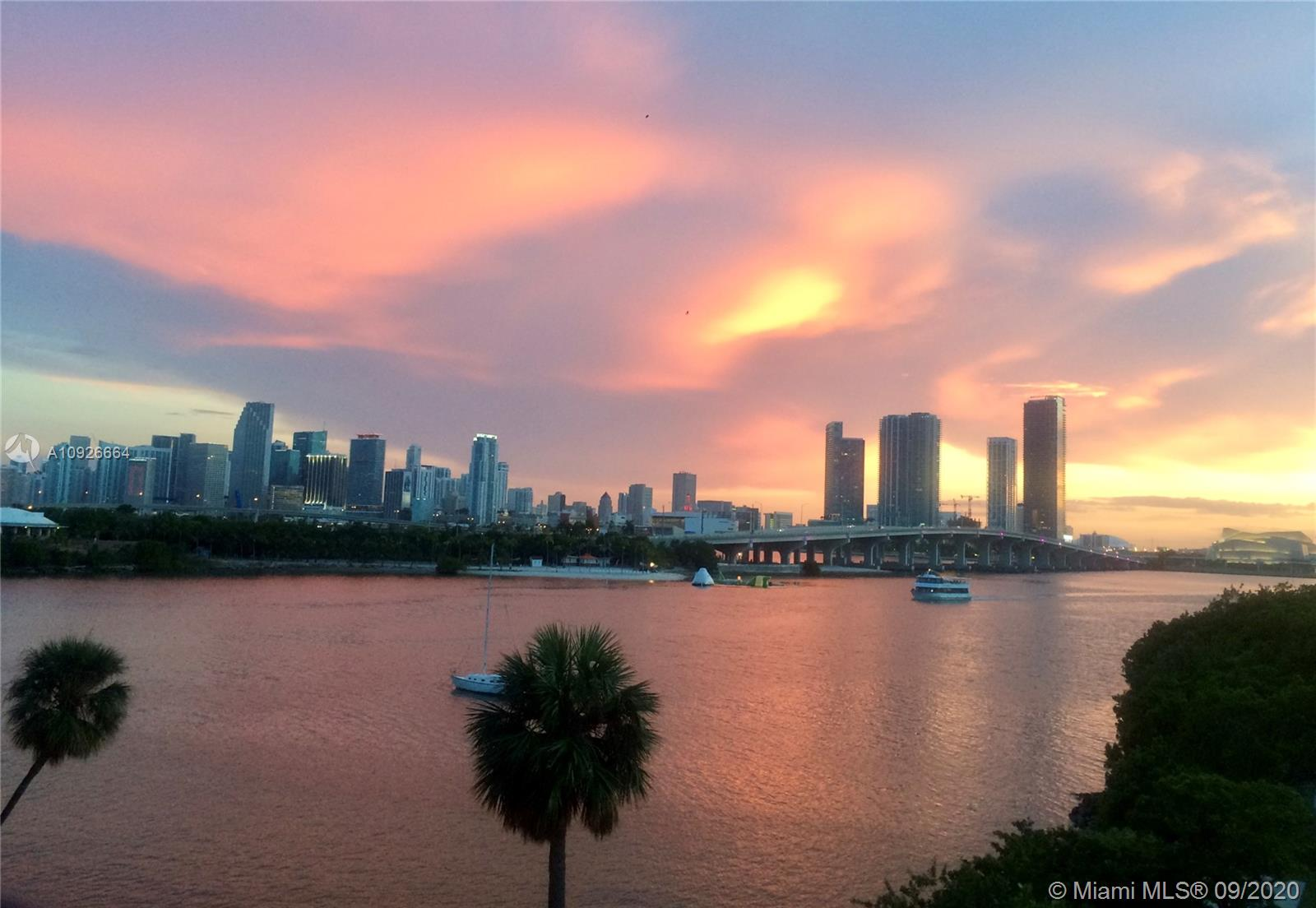 Unique two story corner unit with a million dollar view located in one of the most exclusive areas of Miami and Miami Beach! 9.5 'glass walls that open to huge balconies on each level. The master bedroom and bathroom are on the upper level. Beautiful view of downtown Miami. Unit is located on the water overlooking the beautiful dog park and intercoastal waterway. Hardwood floors downstairs and polished concrete floors upstairs in the bedroom. Lots of mirrors reflecting the incredible view. Stunning views and even the hallway of the Unit has floor to ceiling glass walls. Modern decor.