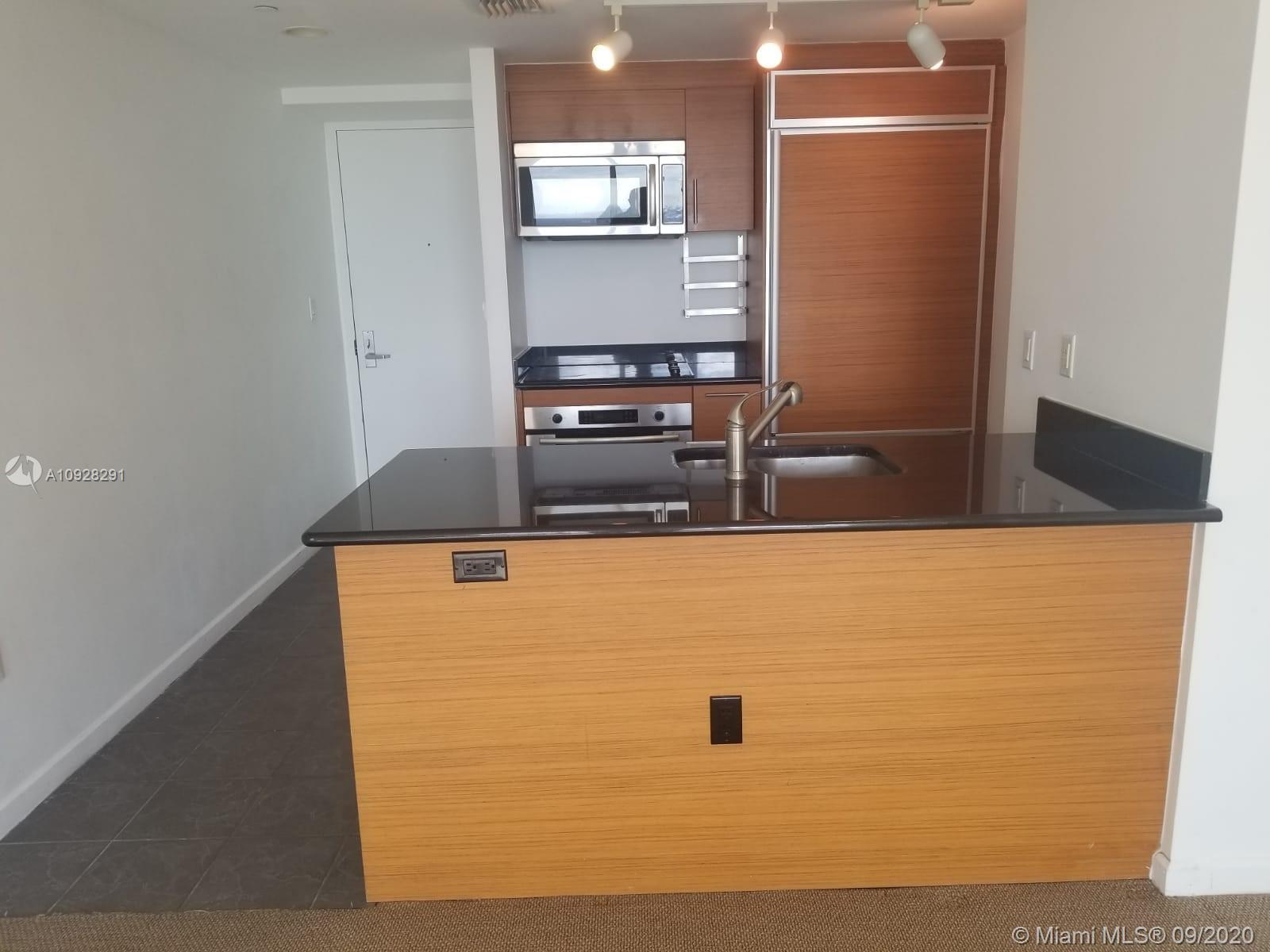 Live in the Miami Skylines famous building 50 Biscayne in Downtown Miami, amazing View of the city, spacious balcony, Italian kitchen & walk in closet. Unit is VACANT, ceramic floors, with one assigned parking space. Excellent location in the heart of Downtown accessible to the metro rail, major expressways and minutes to the beach. Please use Showing Time.