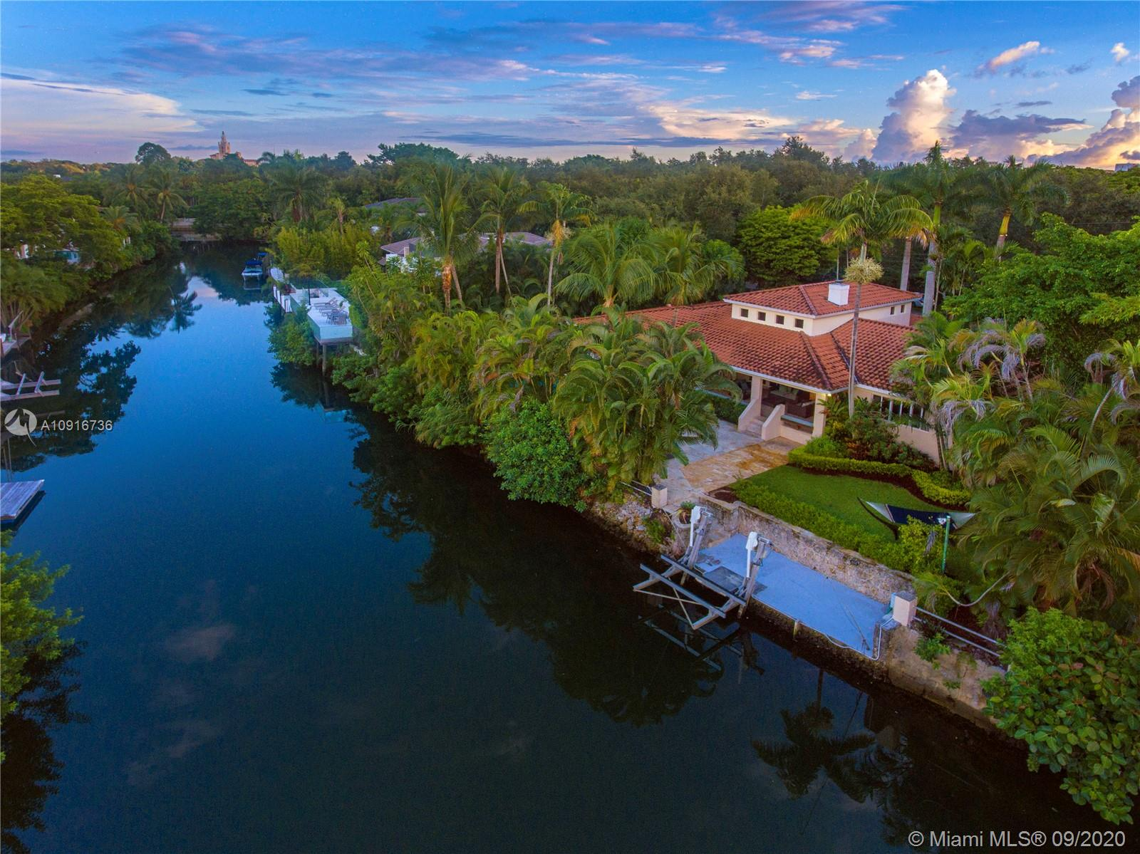 Live the good life on the Coral Gables Waterway. Stunning 4-bedroom, 3.5-bath home, on the best Hurricane safe harbor in South Florida. Solid Coral dock with boat life, 25 minutes from the bay at idle. Beautiful Hardwood kitchen with Onix center island, great room with fireplace and cathedral ceiling with exposed wood beams. Large master suite with bathtub and access to the covered patio and pool. Huge lot, almost 14,500 sq. ft. with large saltwater, heated pool and outdoor shower. Professionally landscaped tropical garden with royal palms and exotic gingers. This home is west of US-1 and minutes from downtown Coral Gables, South Miami, Coconut Grove and the Riviera Golf Club.